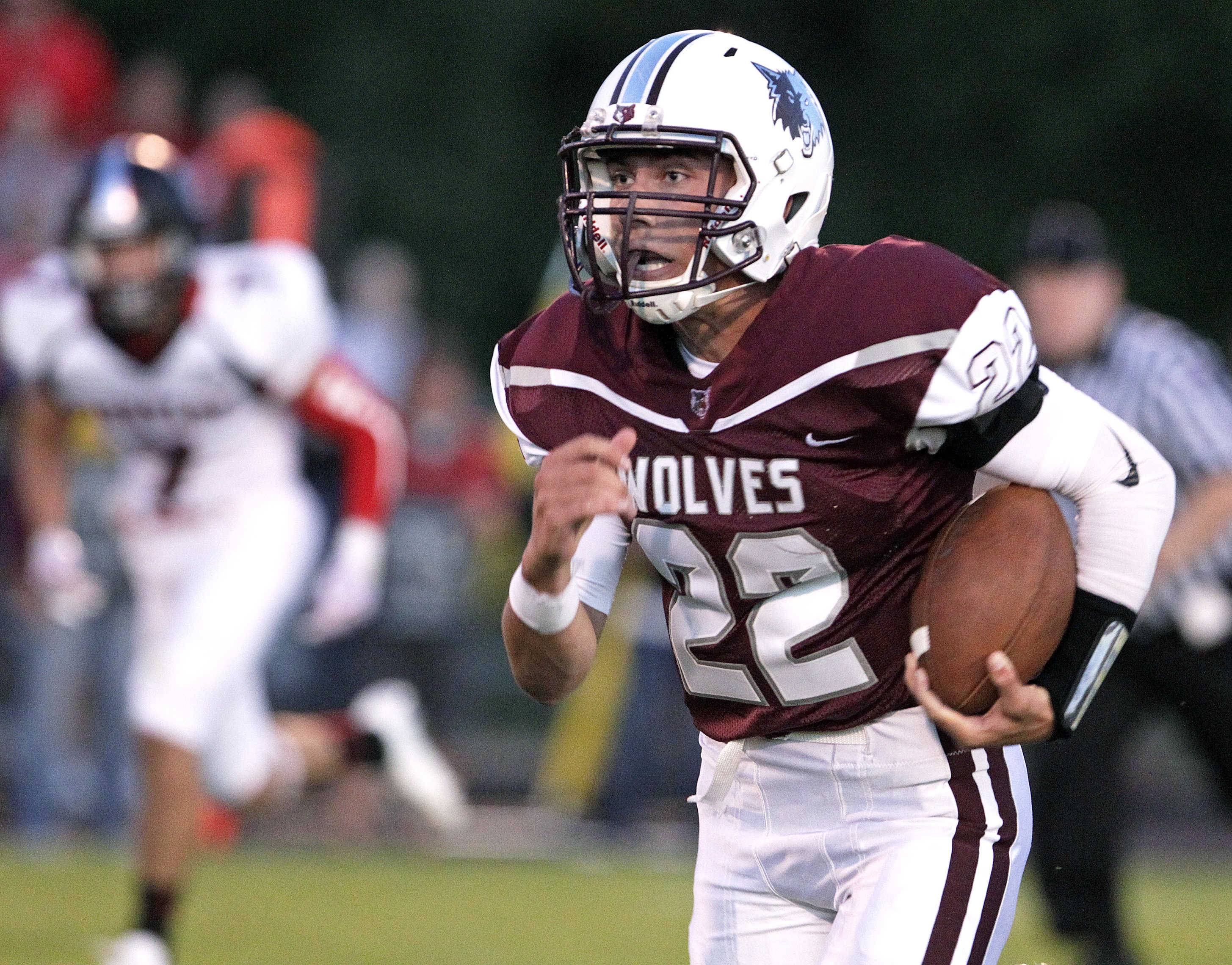 Prairie Ridge's Samson Evans runs 38 yards for a first down in the first quarter against Huntley on Friday.