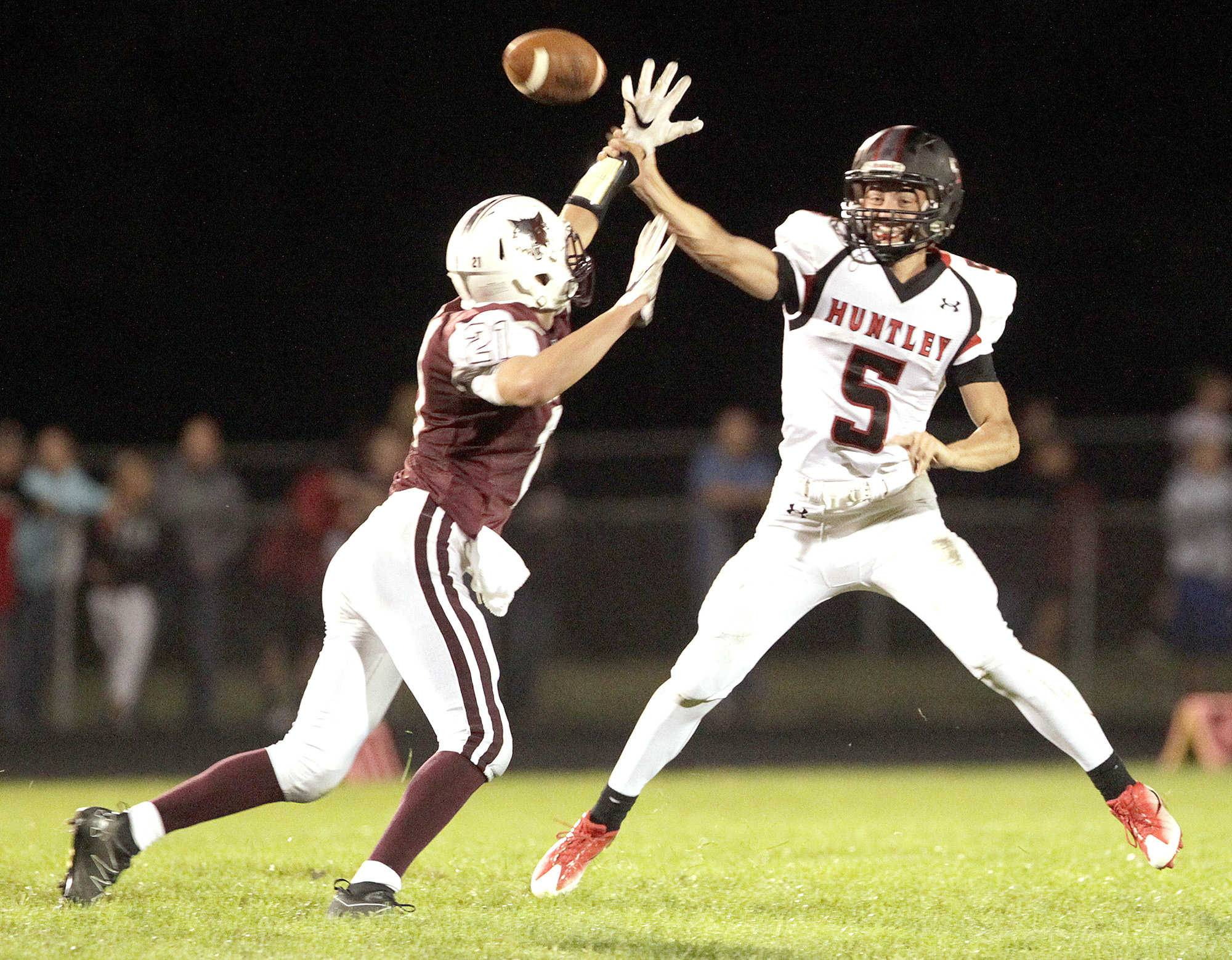 Prairie Ridge's F. Joseph Perhats hurries Huntley's Eric Mooney in the first half on Friday.