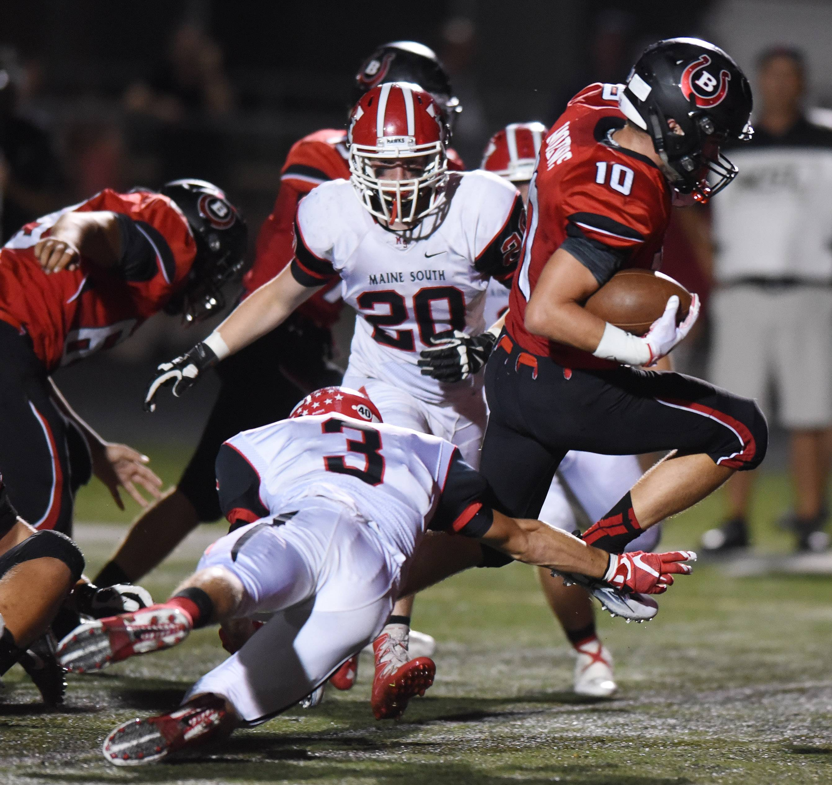 Joe Lewnard/jlewnard@dailyherald.comBarrington's Logan Moews scores a second-quarter touchdown after getting past Maine South's Jack Hoffman (3) during Friday's football game at Barrington.