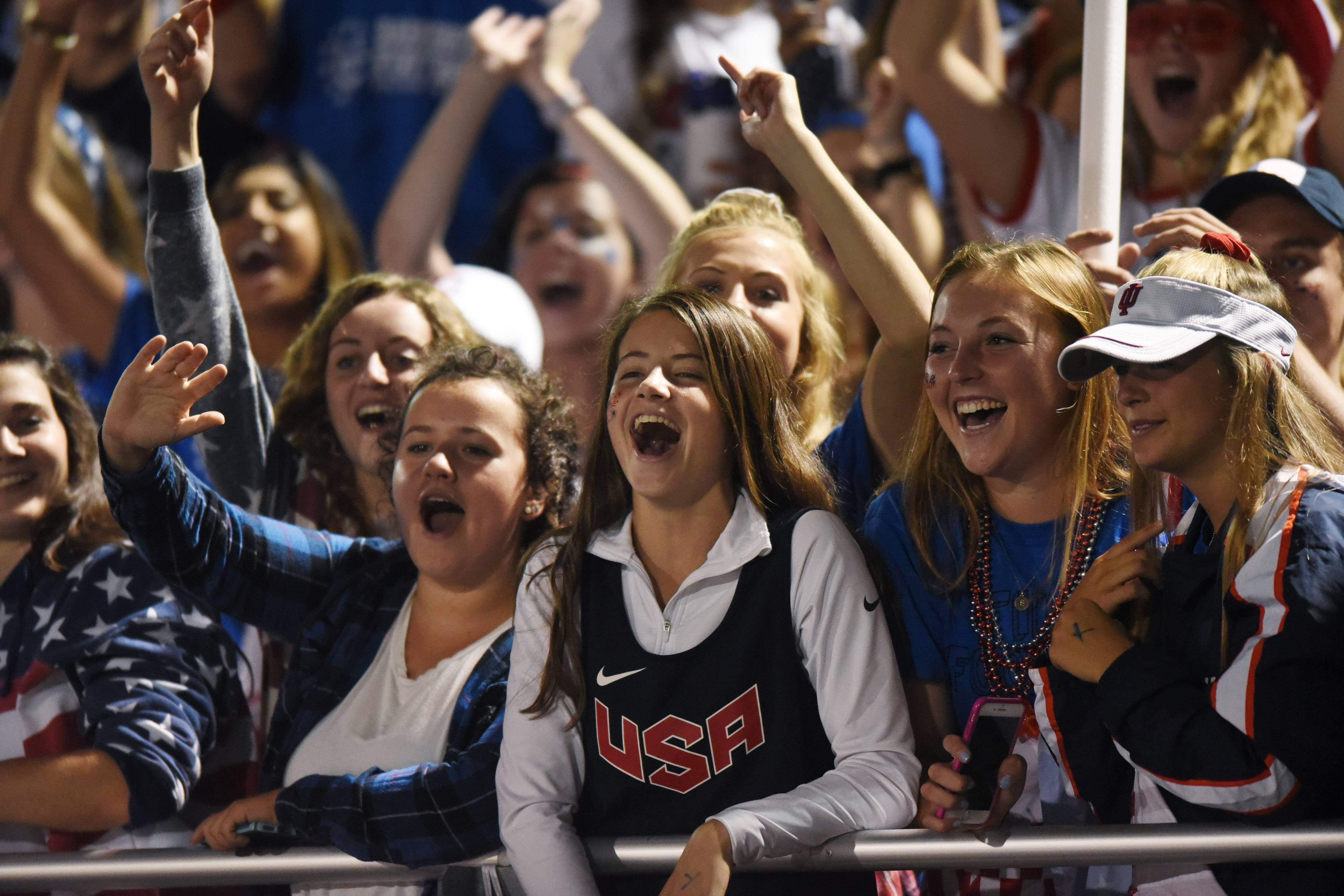 Barrington fans cheer for their team during Friday's football game against Maine South.