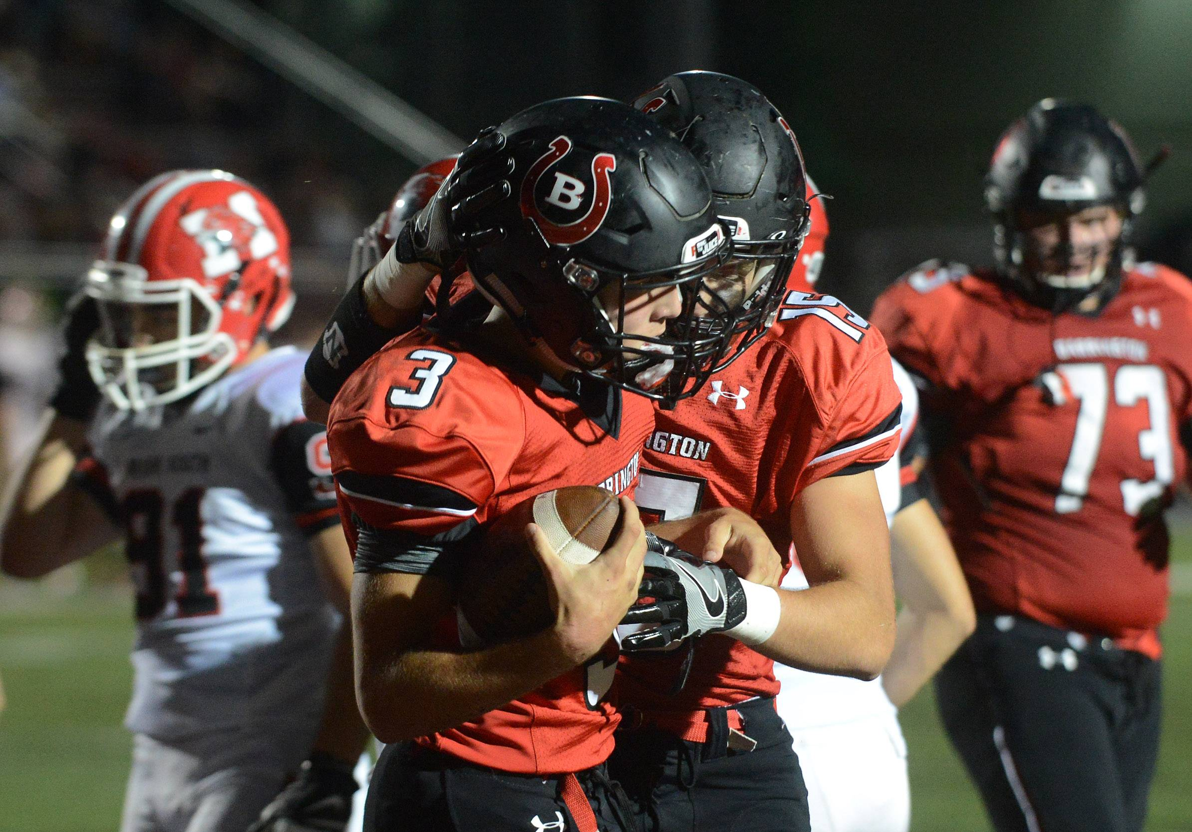 Barrington quarterback Ray Niro (3) celebrates after scoring a first-quarter touchdown against Maine South during Friday's football game at Barrington.