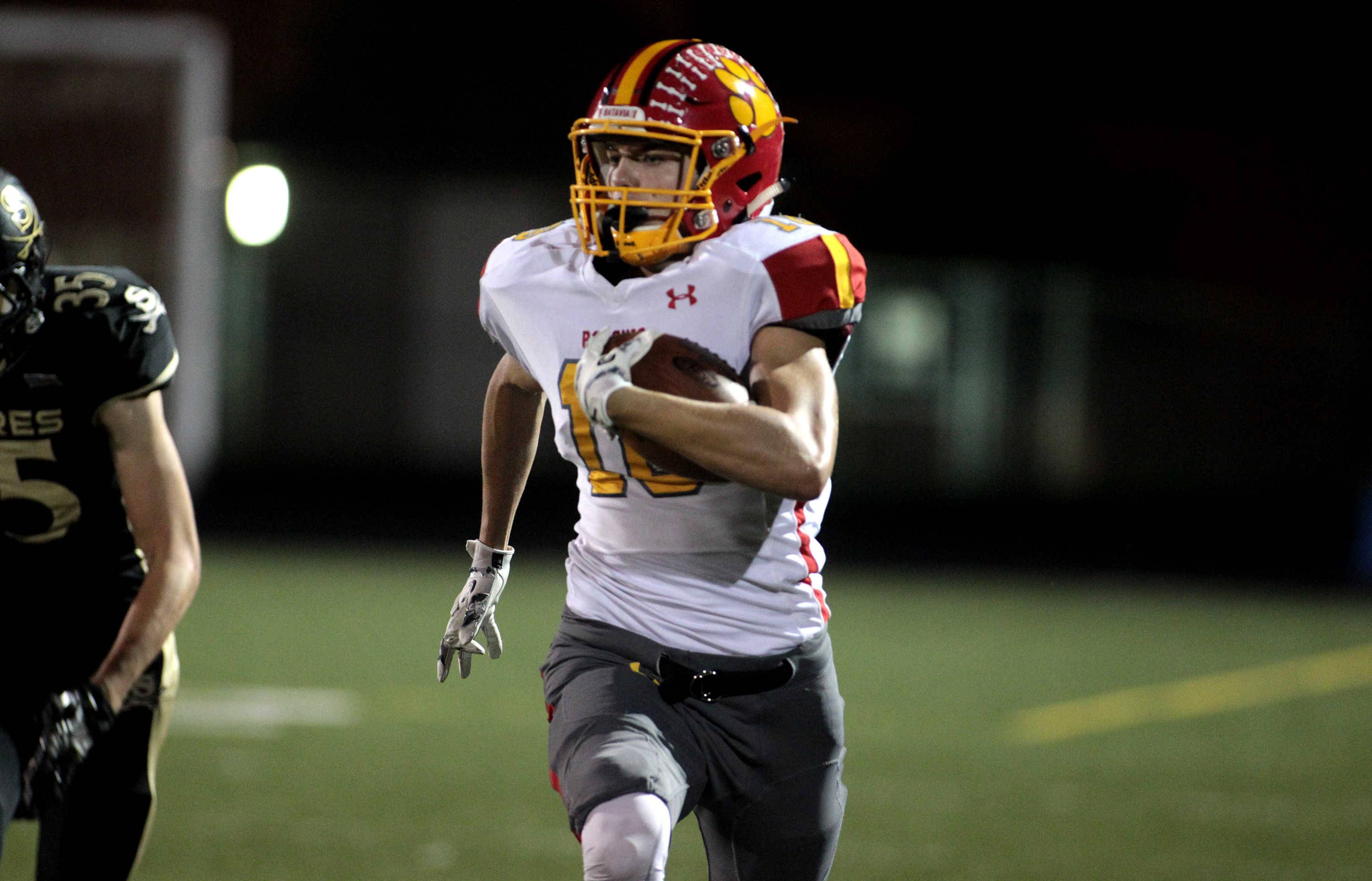 Batavia's Colin Cheaney (18) makes an 88-yard touchdown run during a game at Streamwood Sept. 9.