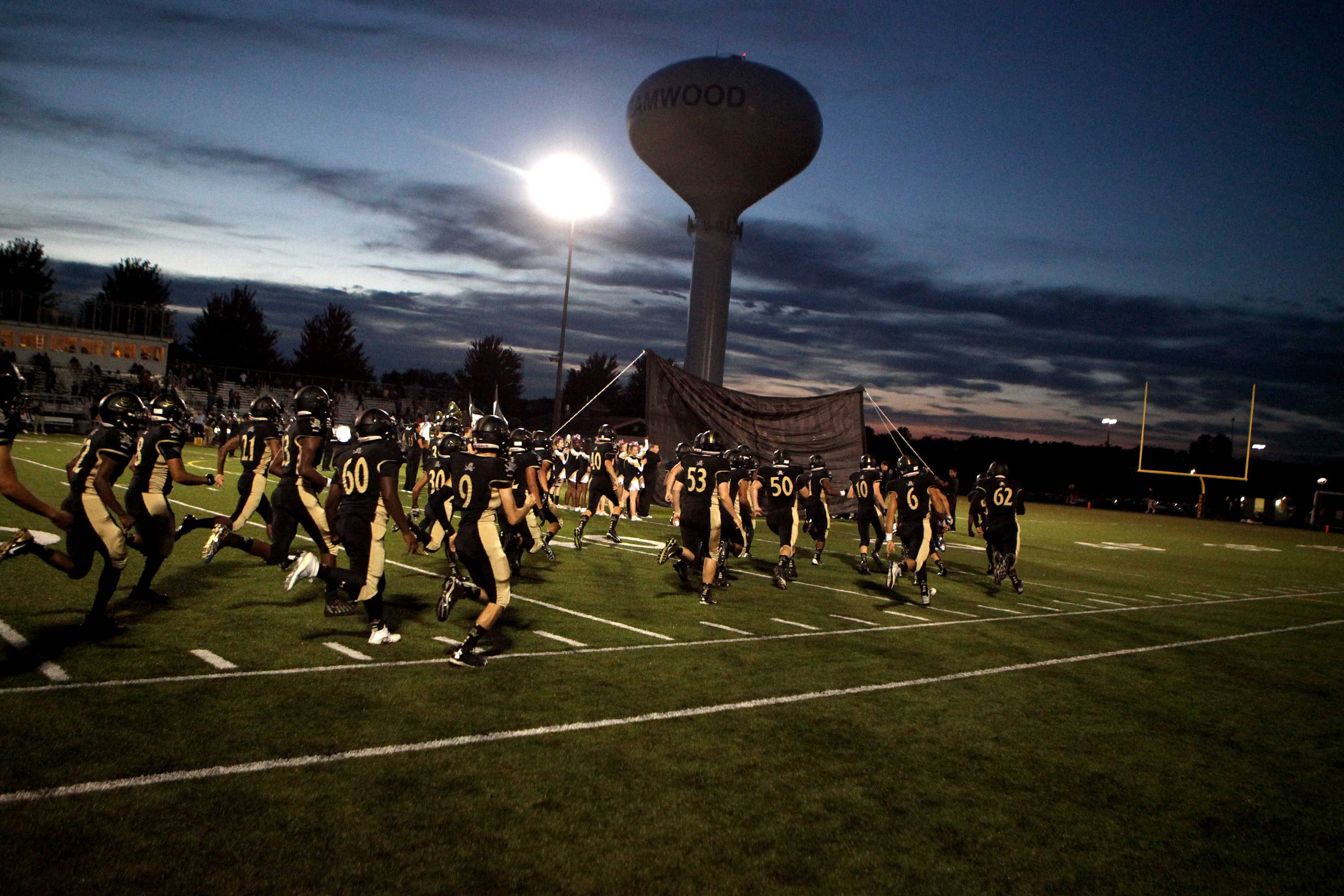 Shaw Media/ Sandy BressnerStreamwood football players take the field before their home game against Batavia Sept. 9.