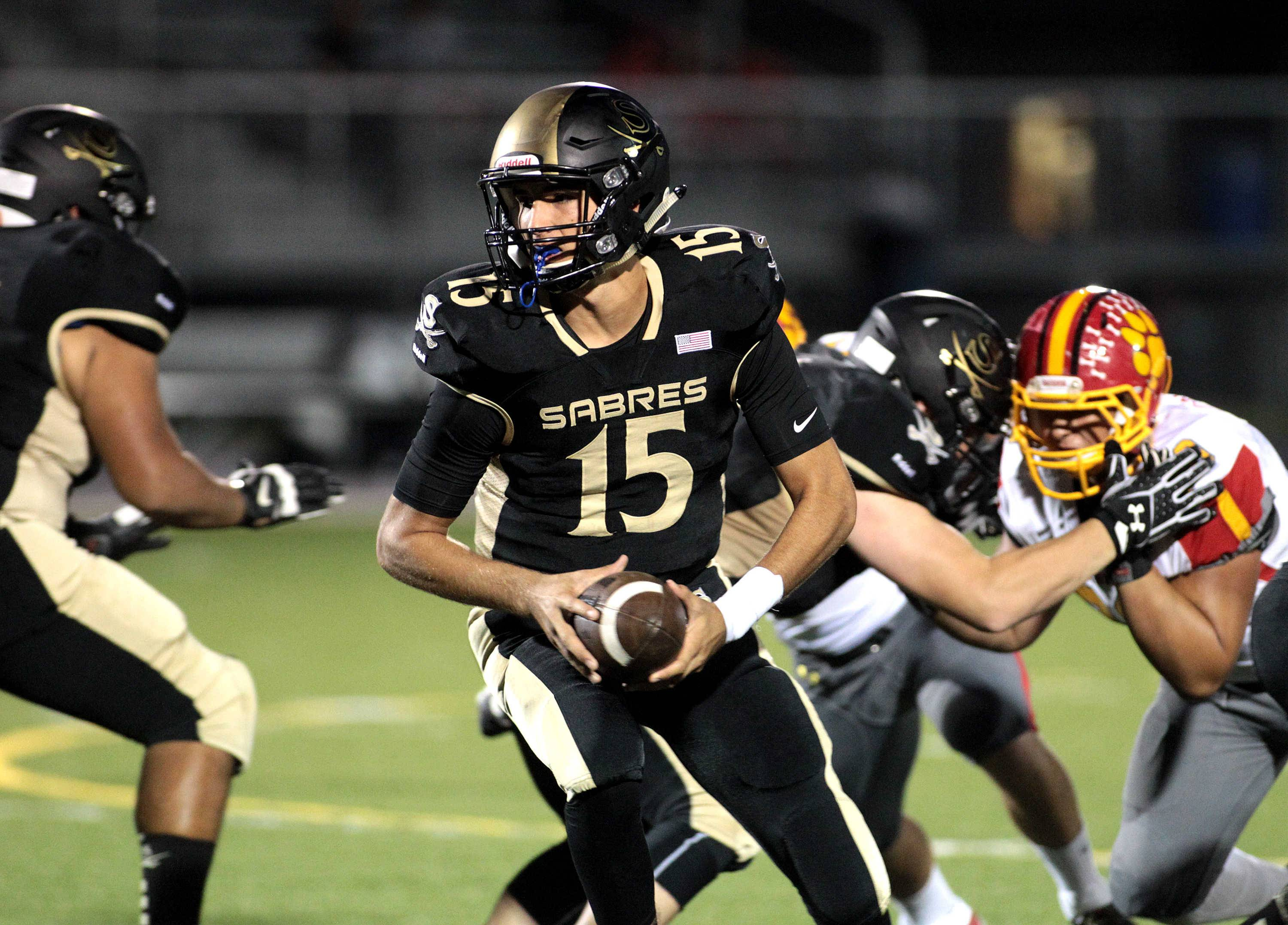 Streamwood quarterback Brendon Marton (15) looks to hand off the ball during a home game against Batavia Sept. 9.