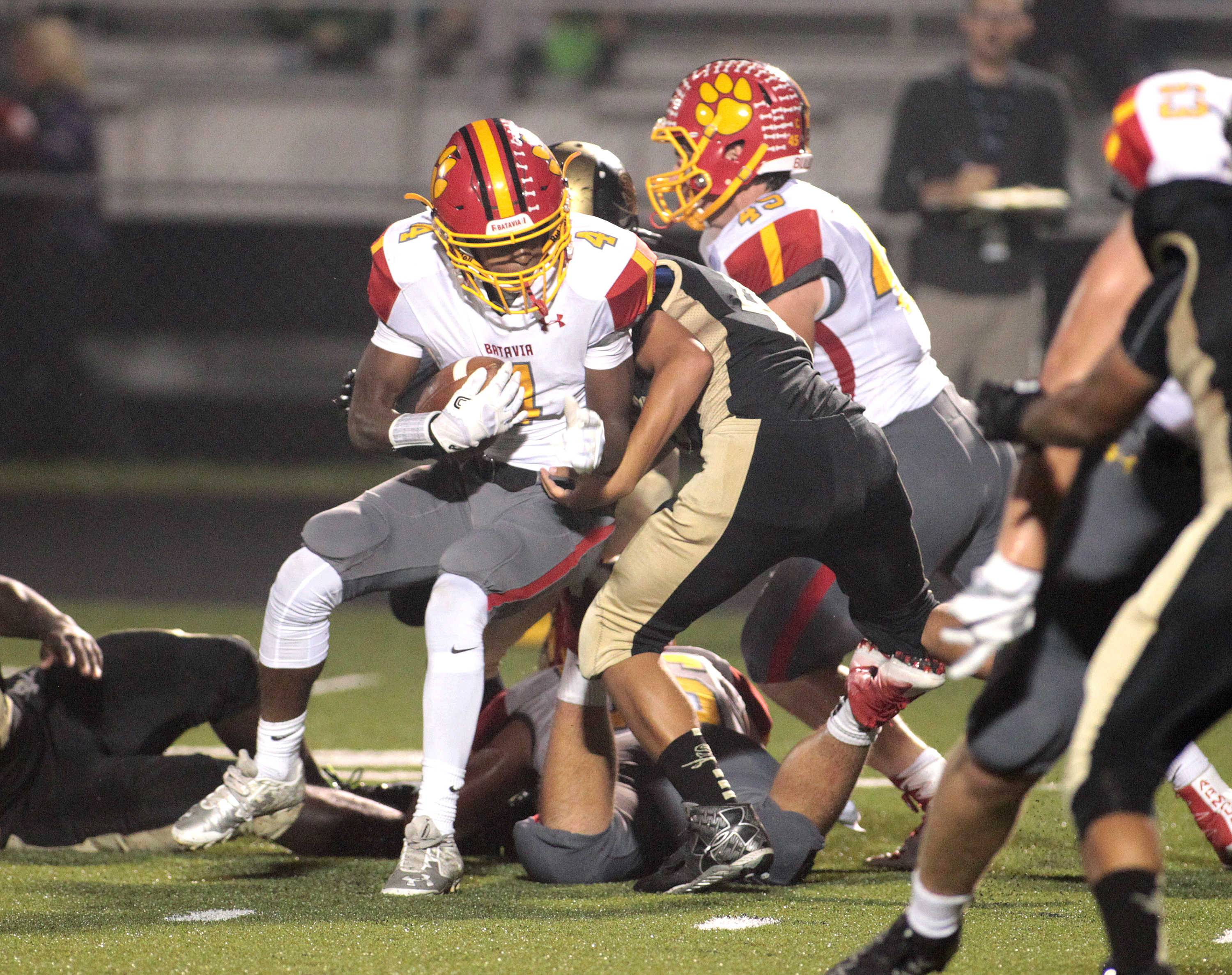 Batavia's Reggie Phillips (4) holds onto the ball while surrounded by Streamwood's defense during a game at Streamwood Sept. 9.