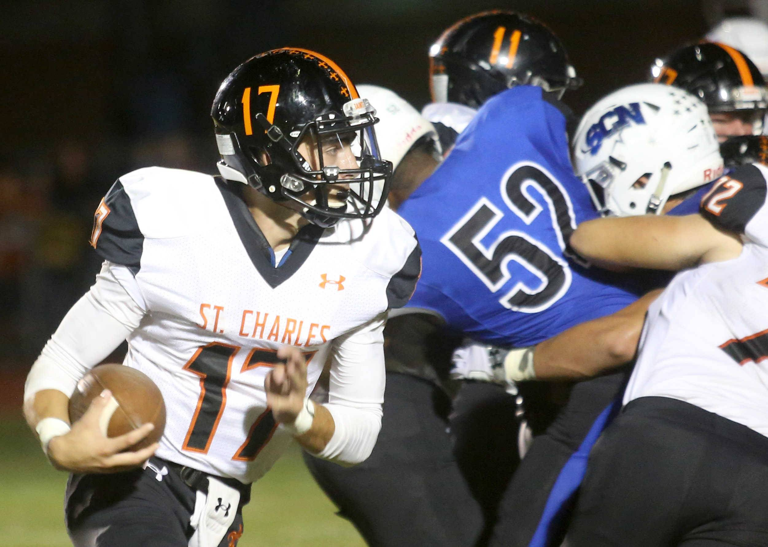 St. Charles East quarterback Zachary Mitchell runs the ball against St. Charles North during the Crosstown Classic football game at St. Charles North Friday night.