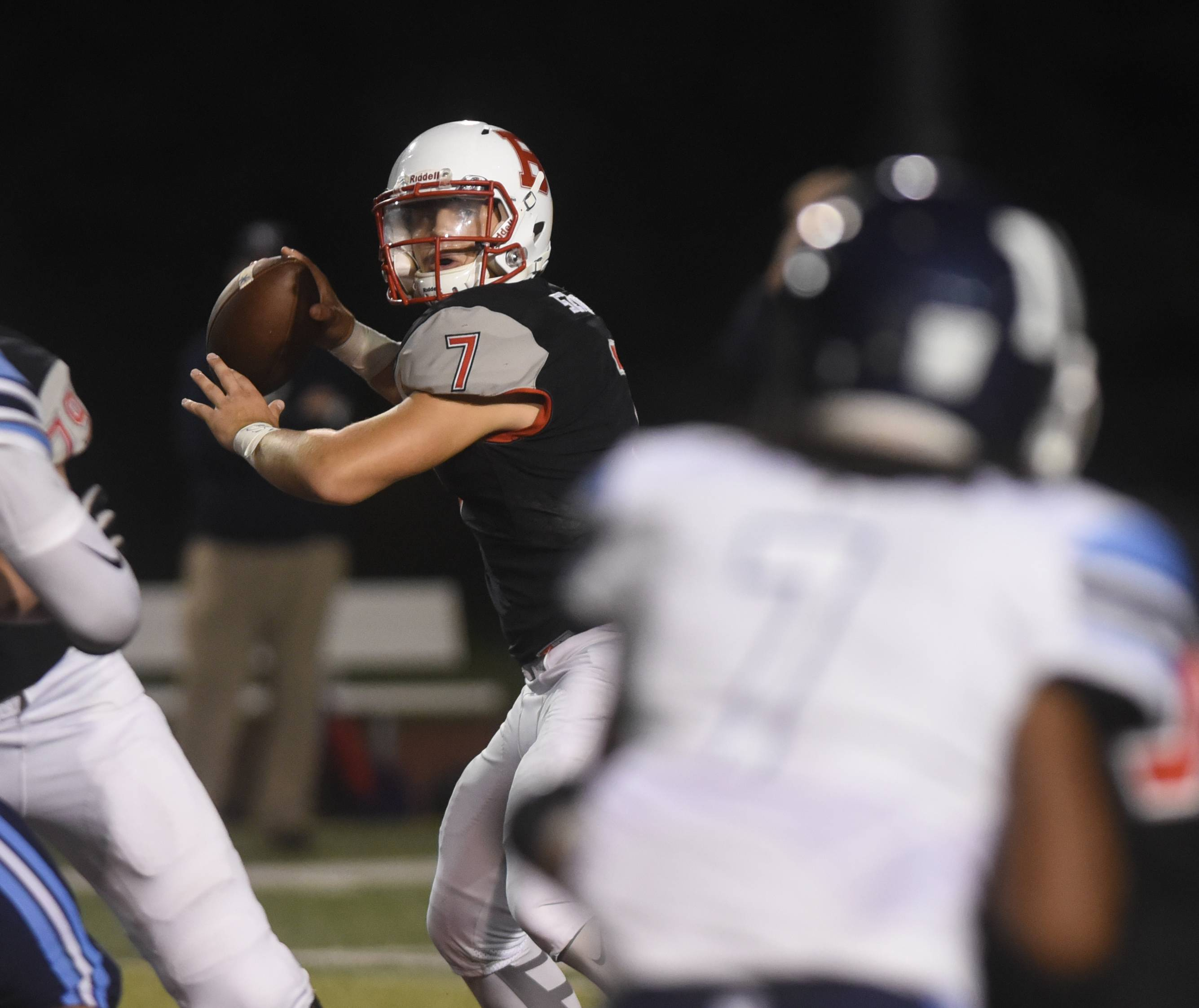 Benet's Jack Sznajder (7) gets ready to pass during the Nazareth at Benet football game Friday.