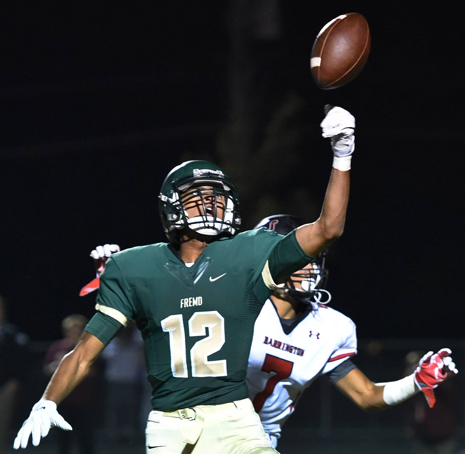 Fremd's Jaden Jackson picks off an interception in the first quarter of Barrington at Fremd in MSL West opener.