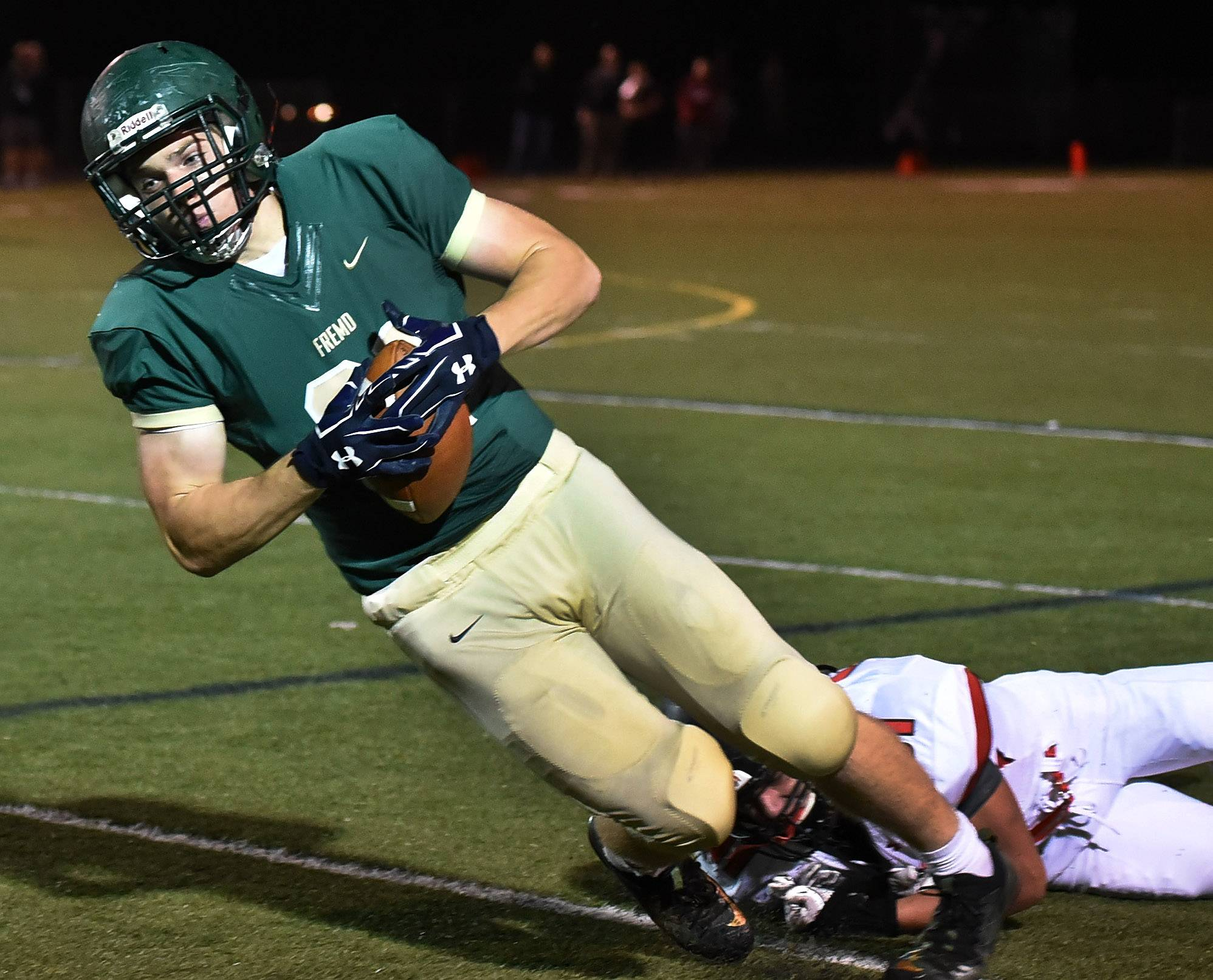 Fremd's Austin Schwantz is tackled near the sidelines after a first-half catch against visiting Barrington on Friday.