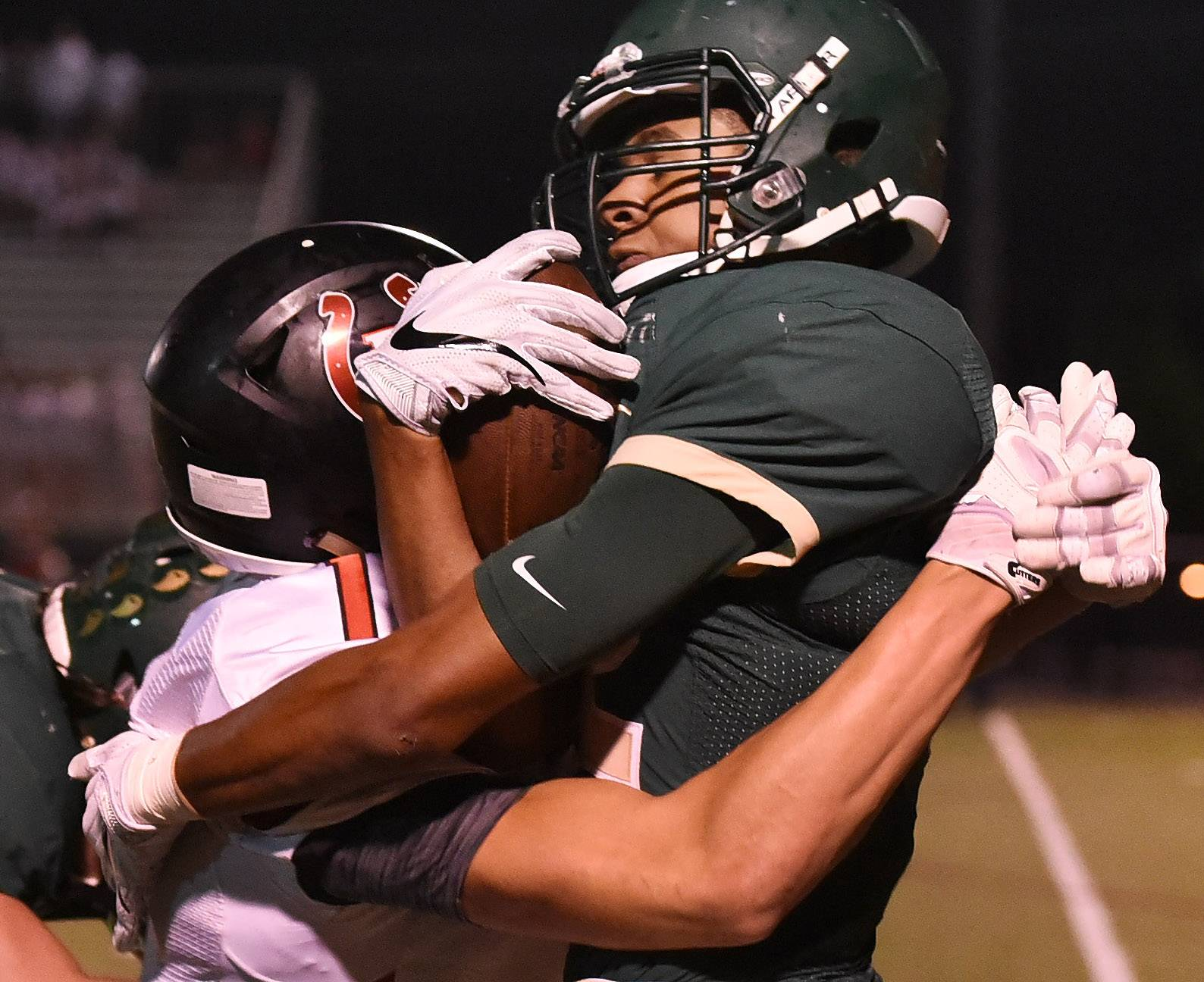 Fremd's Jaden Jackson gets hammered by Barrington's Josh Babicz after making an interception in the first half against Barrington in an MSL West opener Friday.