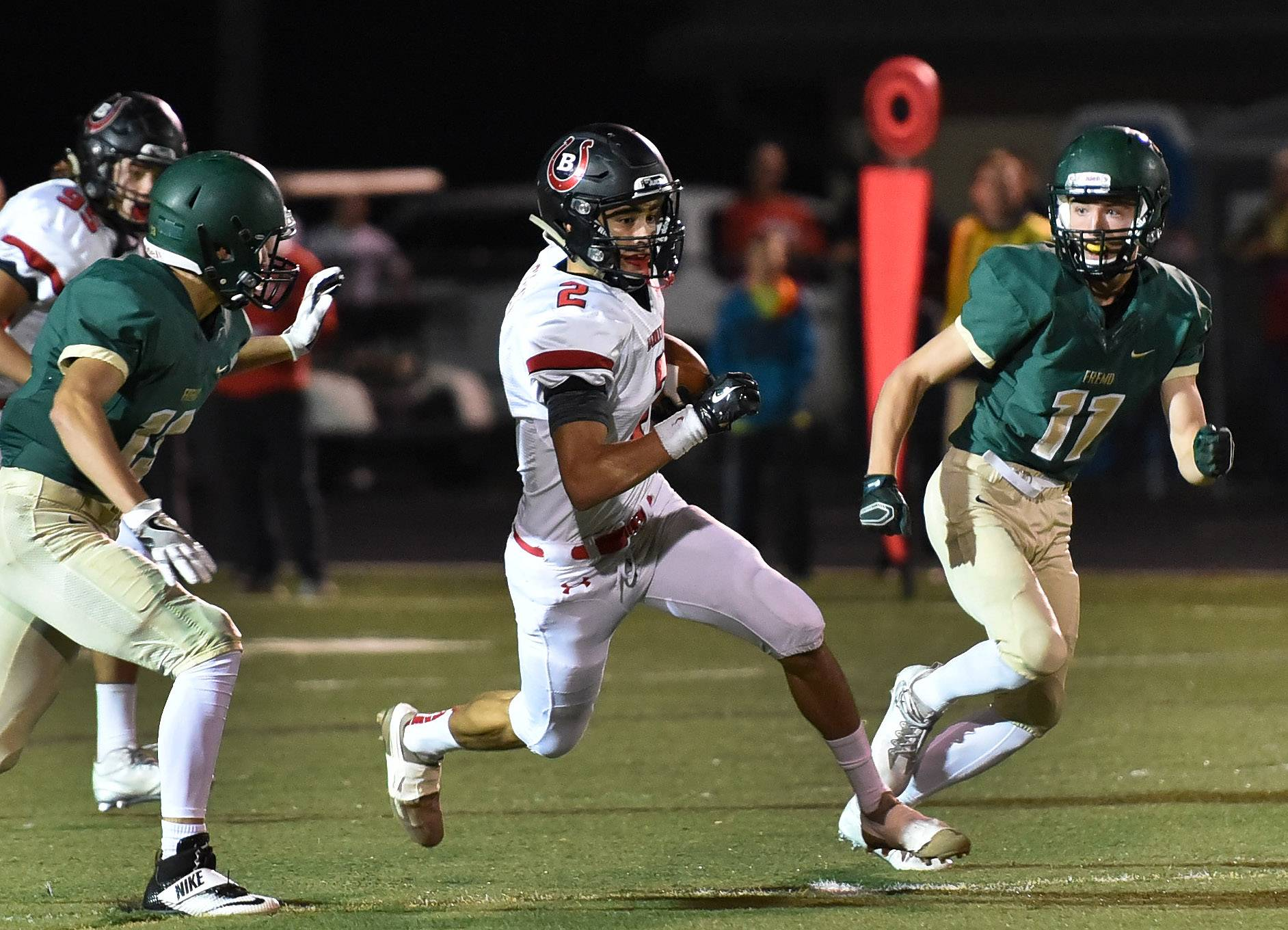 Barrington's Louis Cossio eludes Fremd tacklers in first-half action at Fremd on Friday.