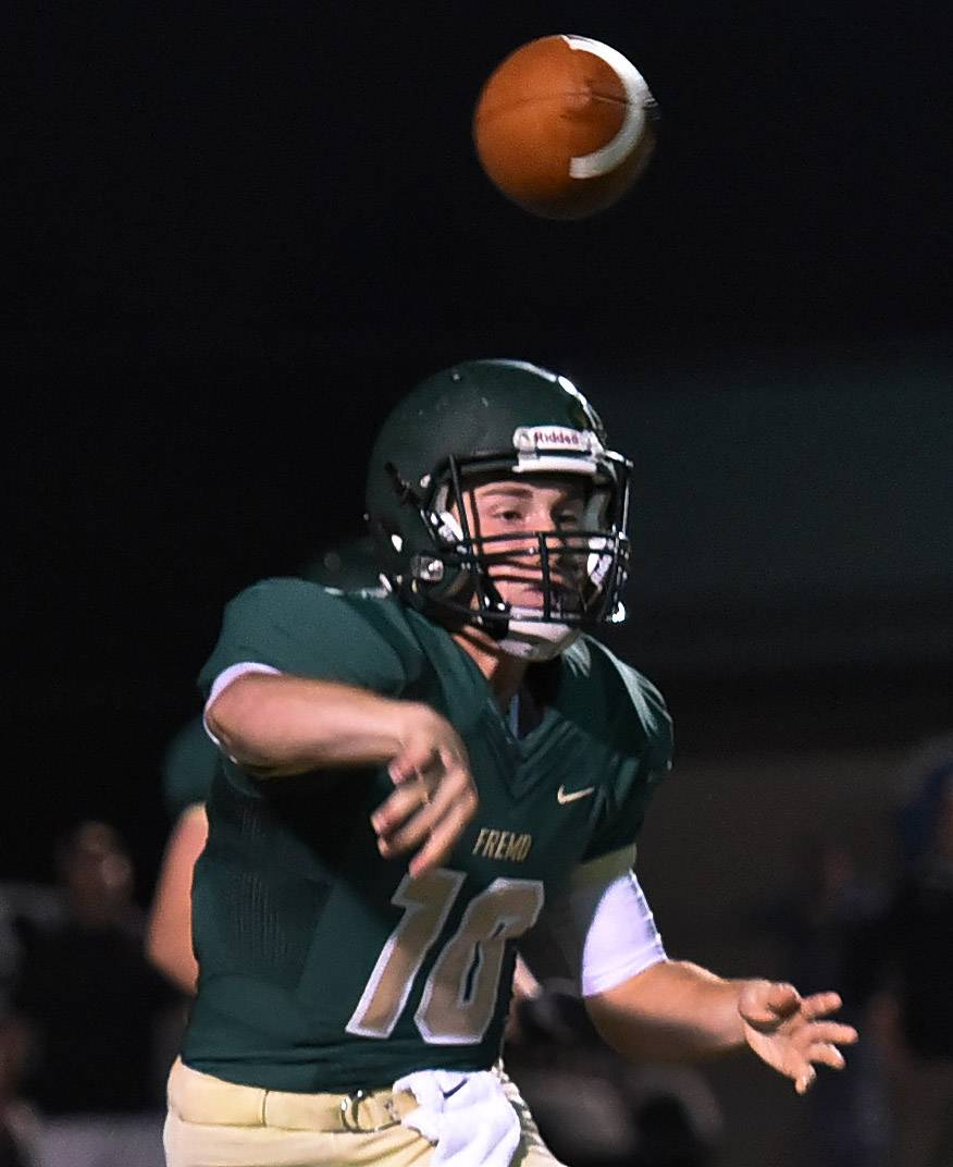 Fremd QB Tom Josten tries to connect with a receiver in first-half action against Barrington on Friday.