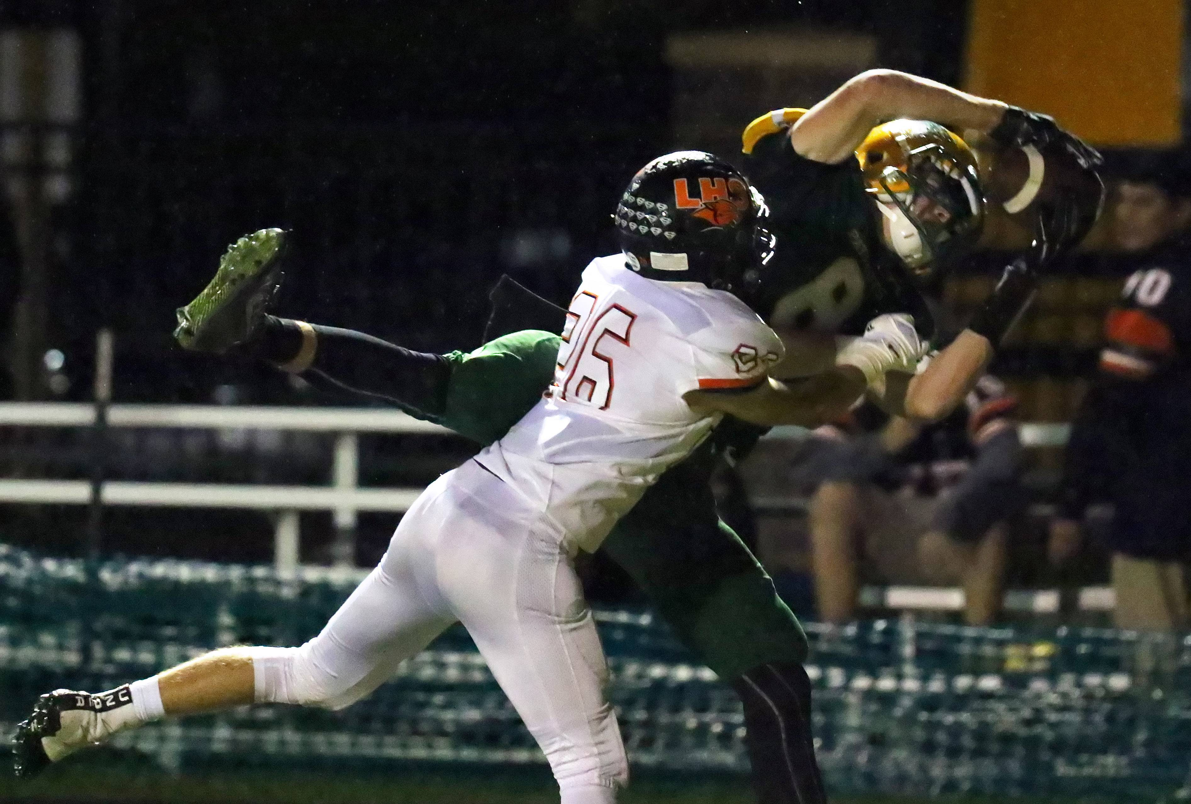 Stevenson's Michael Marchese, right, makes a catch in the end zone as Libertyville's Nathan Boe provides coverage Friday night at Stevenson.