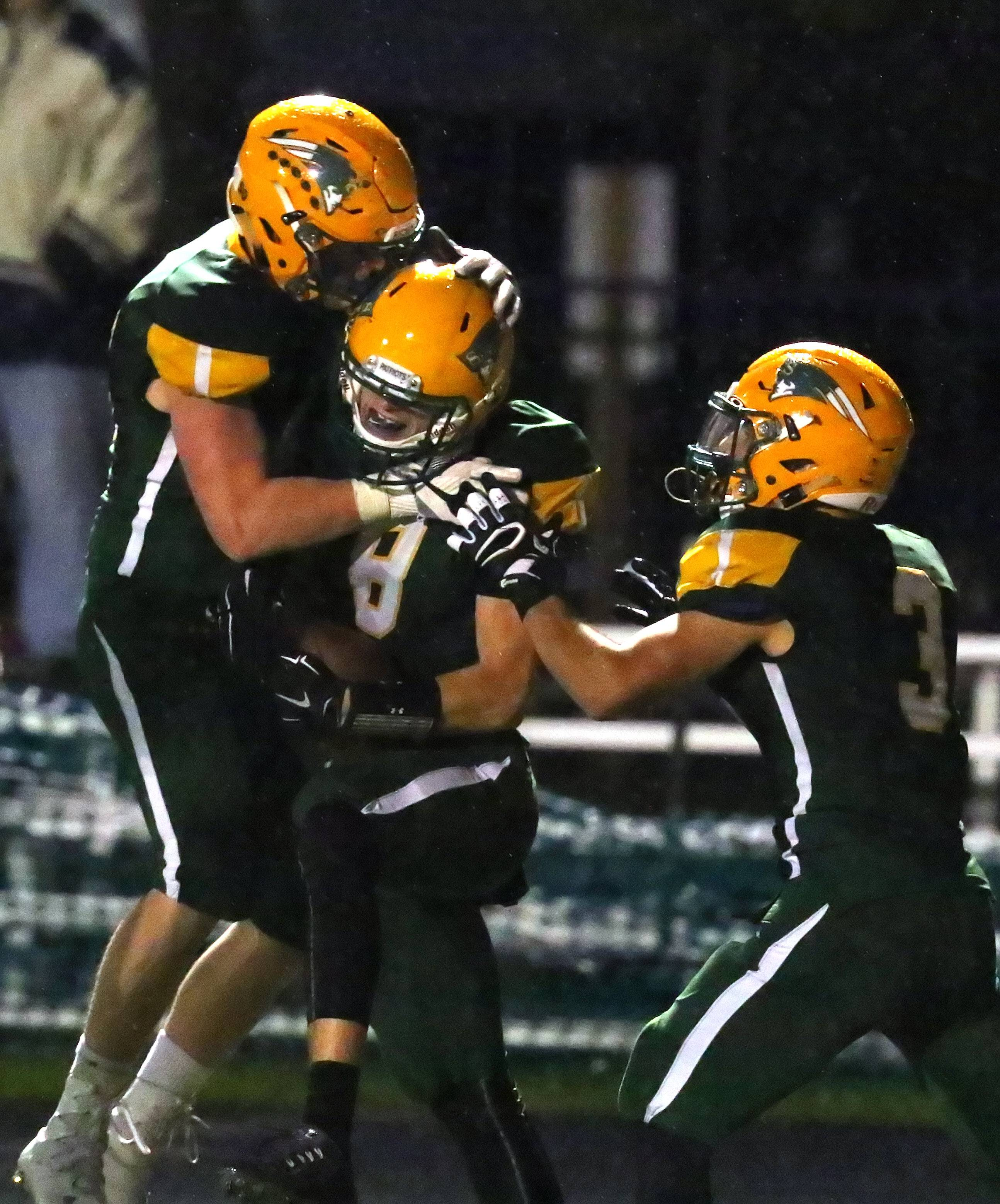 Stevenson's Michael Marchese, middle celebrates with teammates after a touchdown catch against Libertyville on Friday night in Lincolnshire.