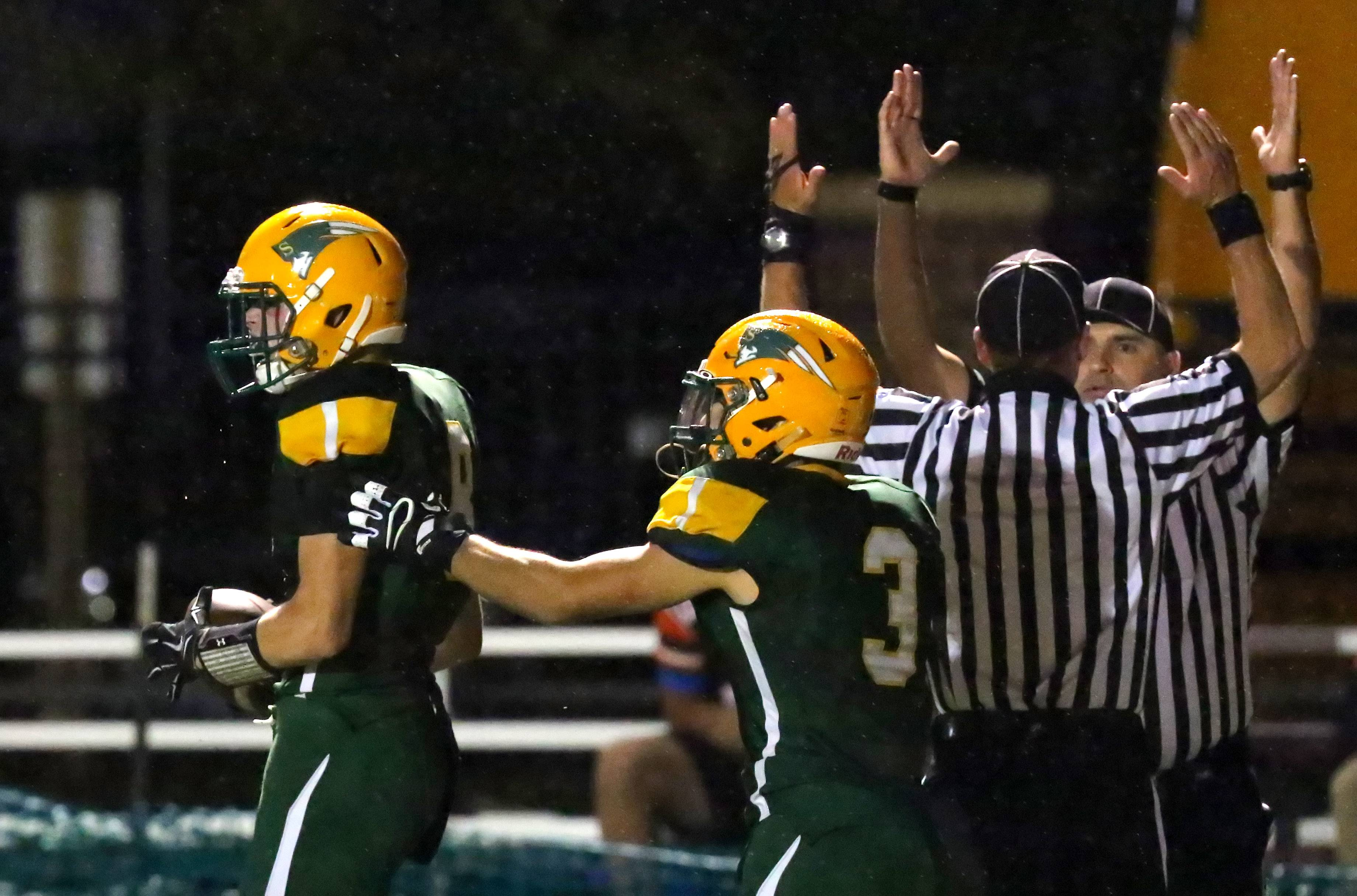 Stevenson's Michael Marchese, left, celebrates with Anthony Sibo after a touchdown catch against Libertyville on Friday night at Stevenson.
