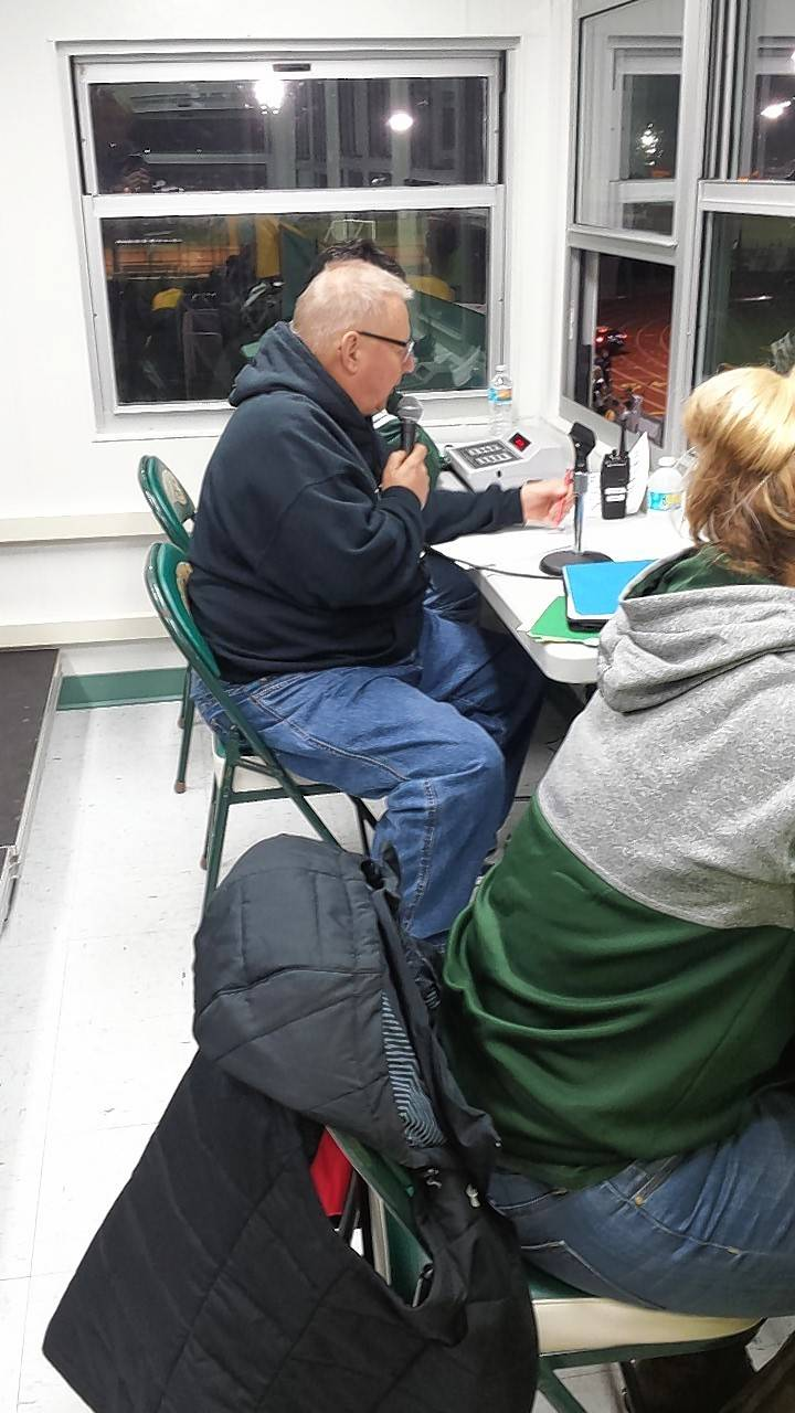 Public address announcer extraordinaire Ken Grams works Friday's Mid-Suburban League football game between Elk Grove and Wheeling. Grams has not missed a football home game in the Grenadiers' 50-year history.