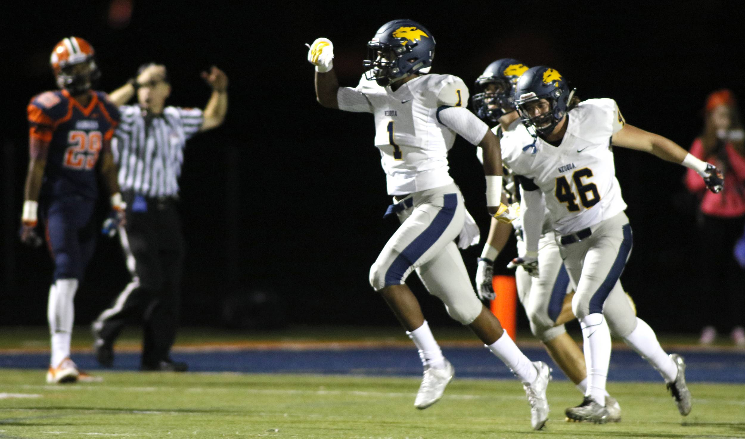 Neuqua Valley's Isaiah Robertson (1) celebrates scoring his first half fumble recovery which he ran back for a touchdown against Naperville North.