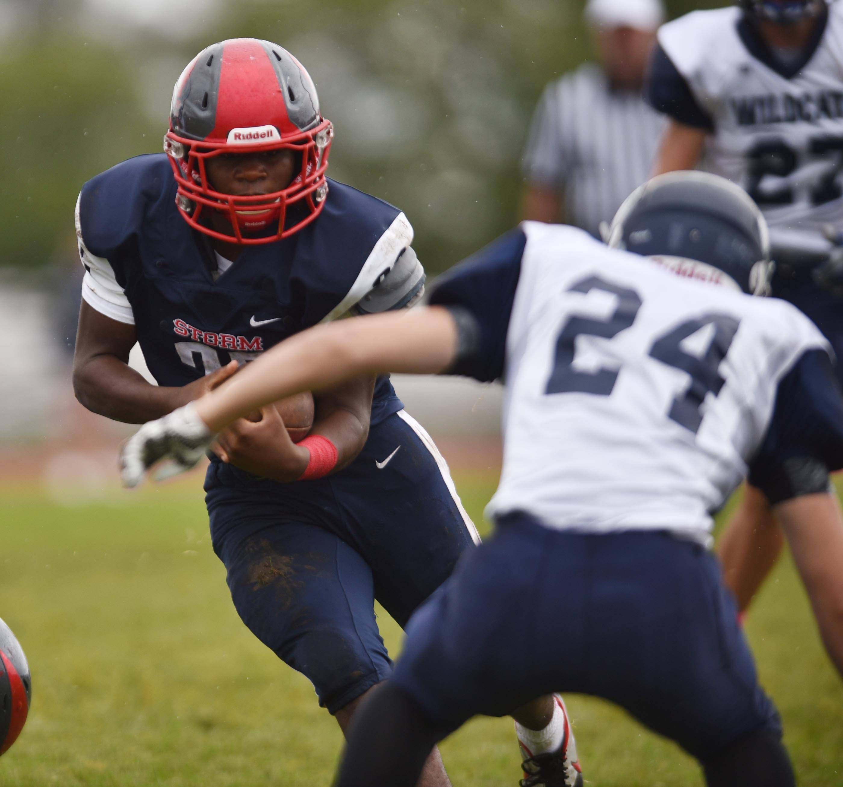 South Elgin's Monte Mardis tries to avoid West Chicago's DJ Poisson Saturday in South Elgin.