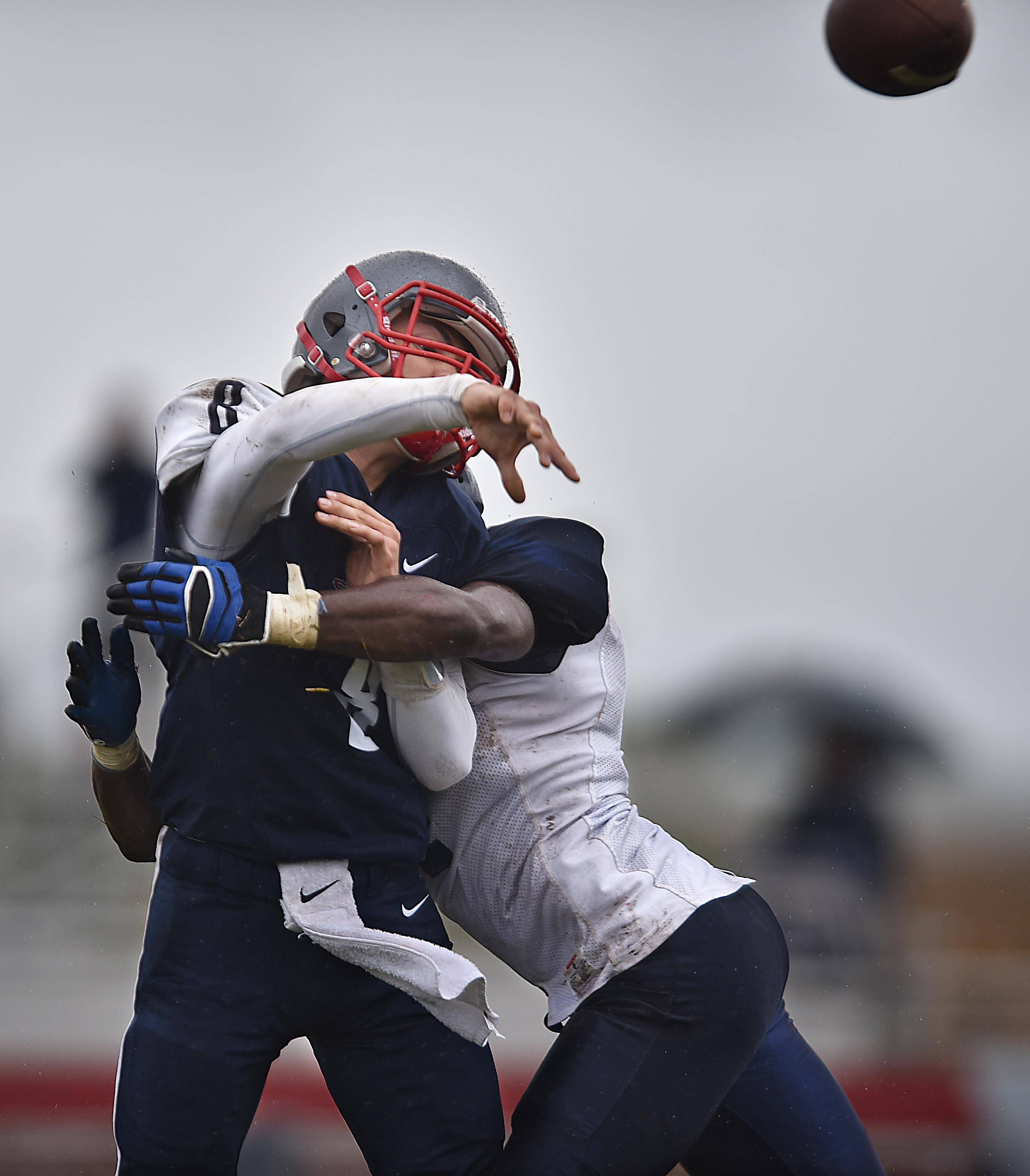 South Elgin's Nate Gomez is hit by West Chicago's Devonte Pascal as he delivers a first down pass to teammate Azxavier Salinas Saturday in South Elgin.
