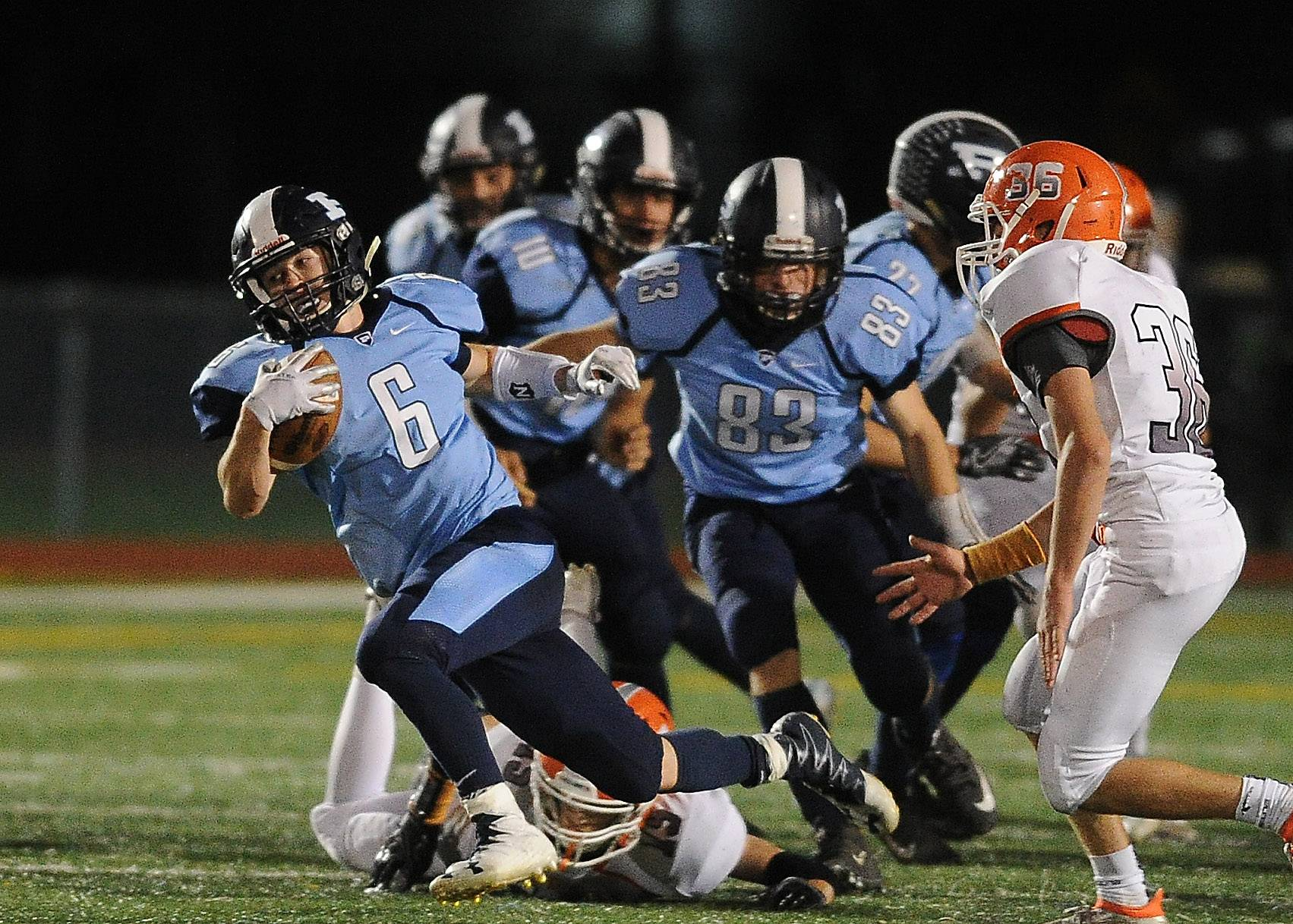 Prospect's Dante Cecala returns a punt but is tripped up by the Hersey defense on Friday at Prospect.