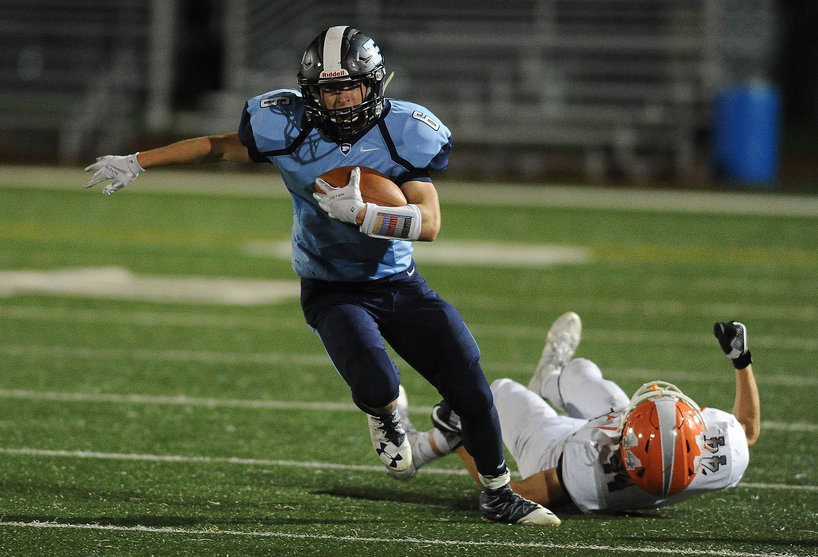 Prospect's Dante Cecala plows ahead against Hersey's Colton Kamysz for a 17-yard gain in the first half Friday at Prospect.