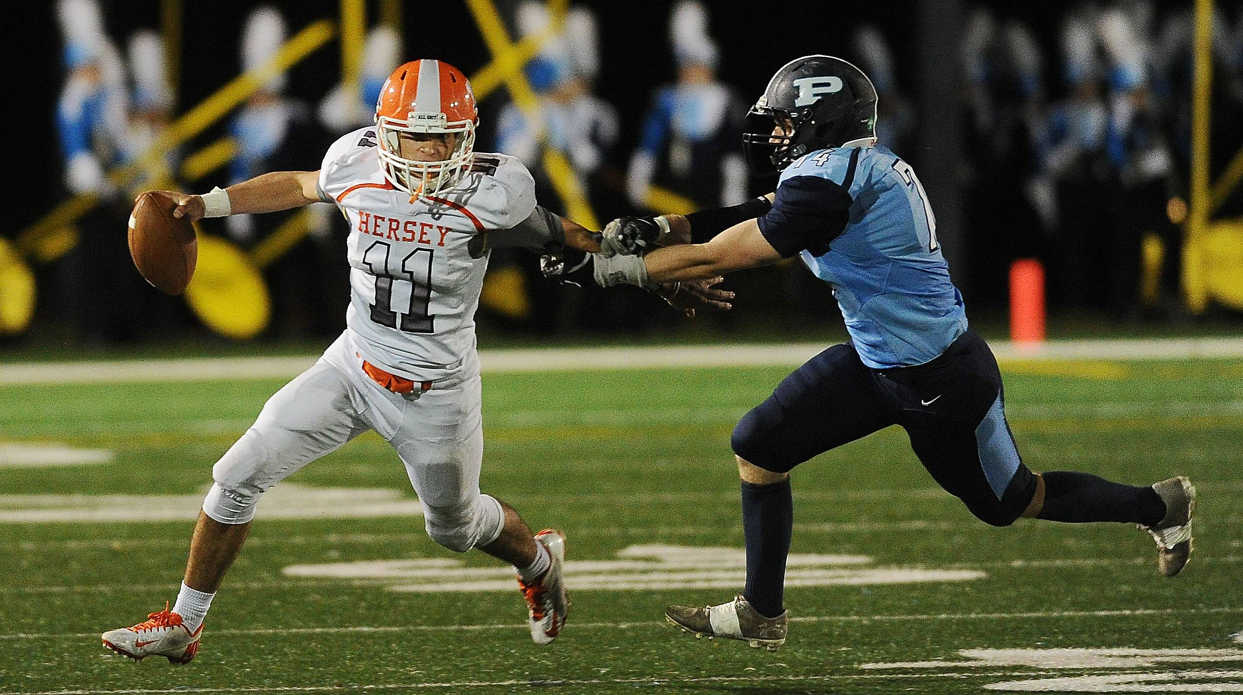 Hersey quarterback Owen Goldsberry shakes loose from Prospect defender Luke Reinhardt on Friday at Prospect.