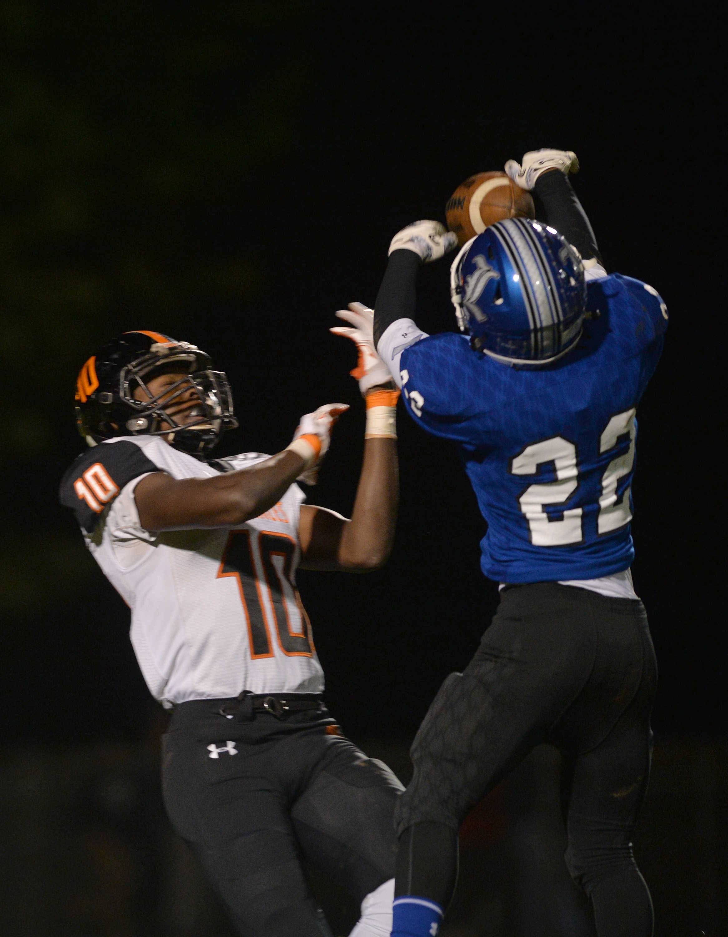 Larkin defensive back Denzel Goodwin (22) defends a pass intended for St. Charles East's Clayton Isbell in the second quarter of their Upstate Eight River contest Friday night at Memorial Field in Elgin.