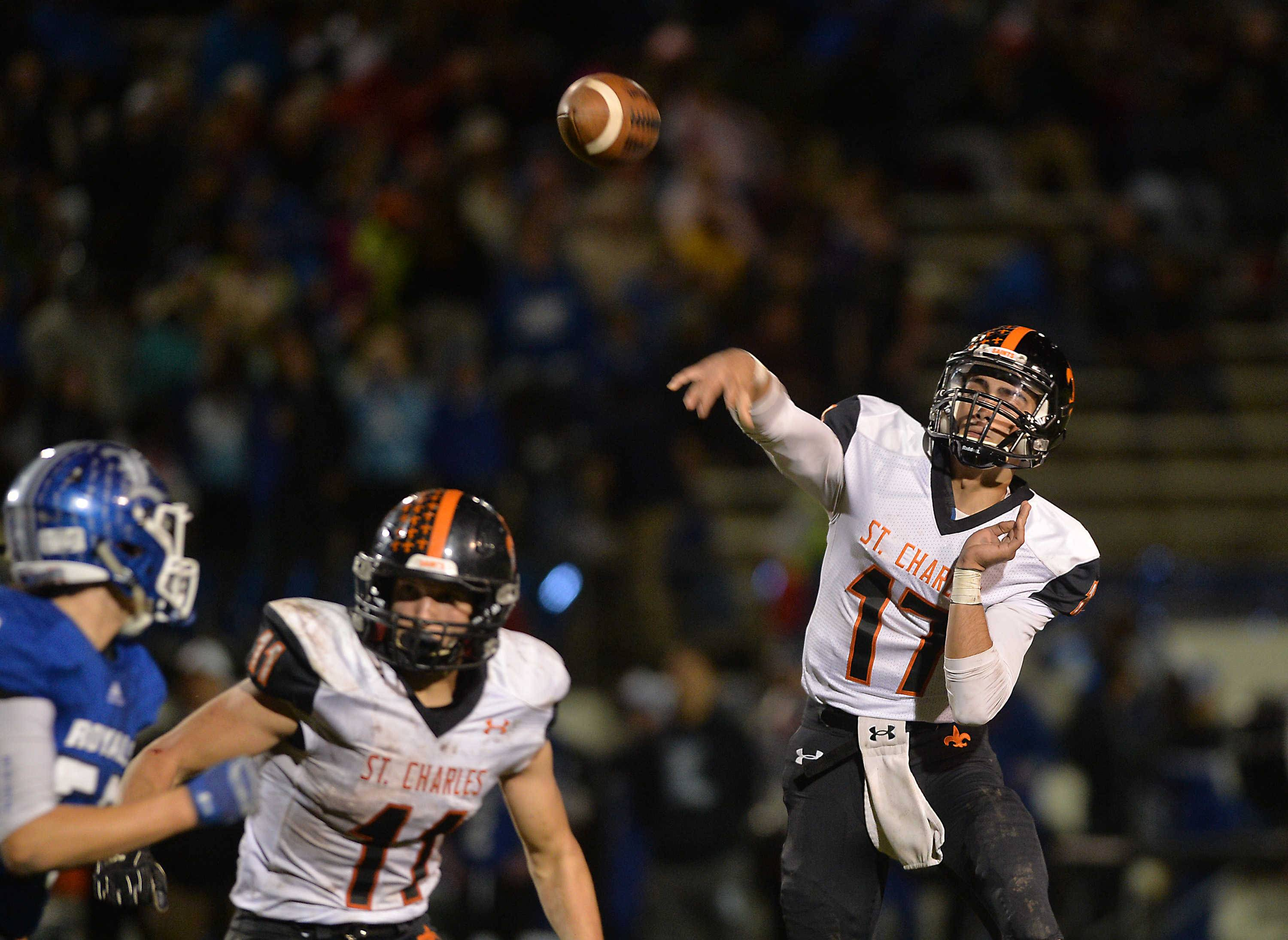 St. Charles East quarterback Zachary Mitchell passes in the second quarter of their Upstate Eight contest Friday night at Memorial Field in Elgin.