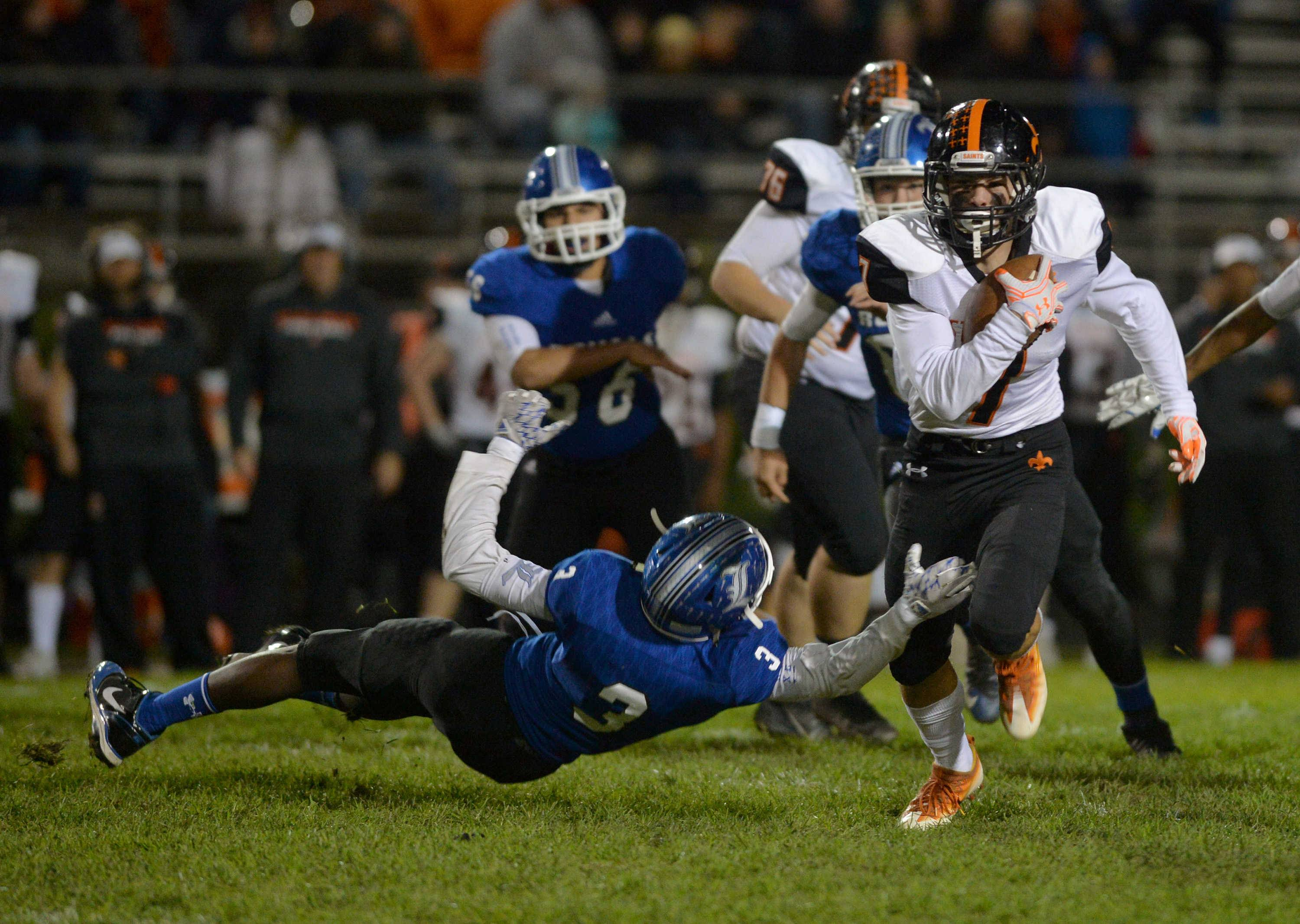 St. Charles East running back Nicholas Garlisch tries to shake Larkin defensive back Elijah Hernanez in the first quarter of their Upstate Eight contest Friday night at Memorial Field in Elgin.