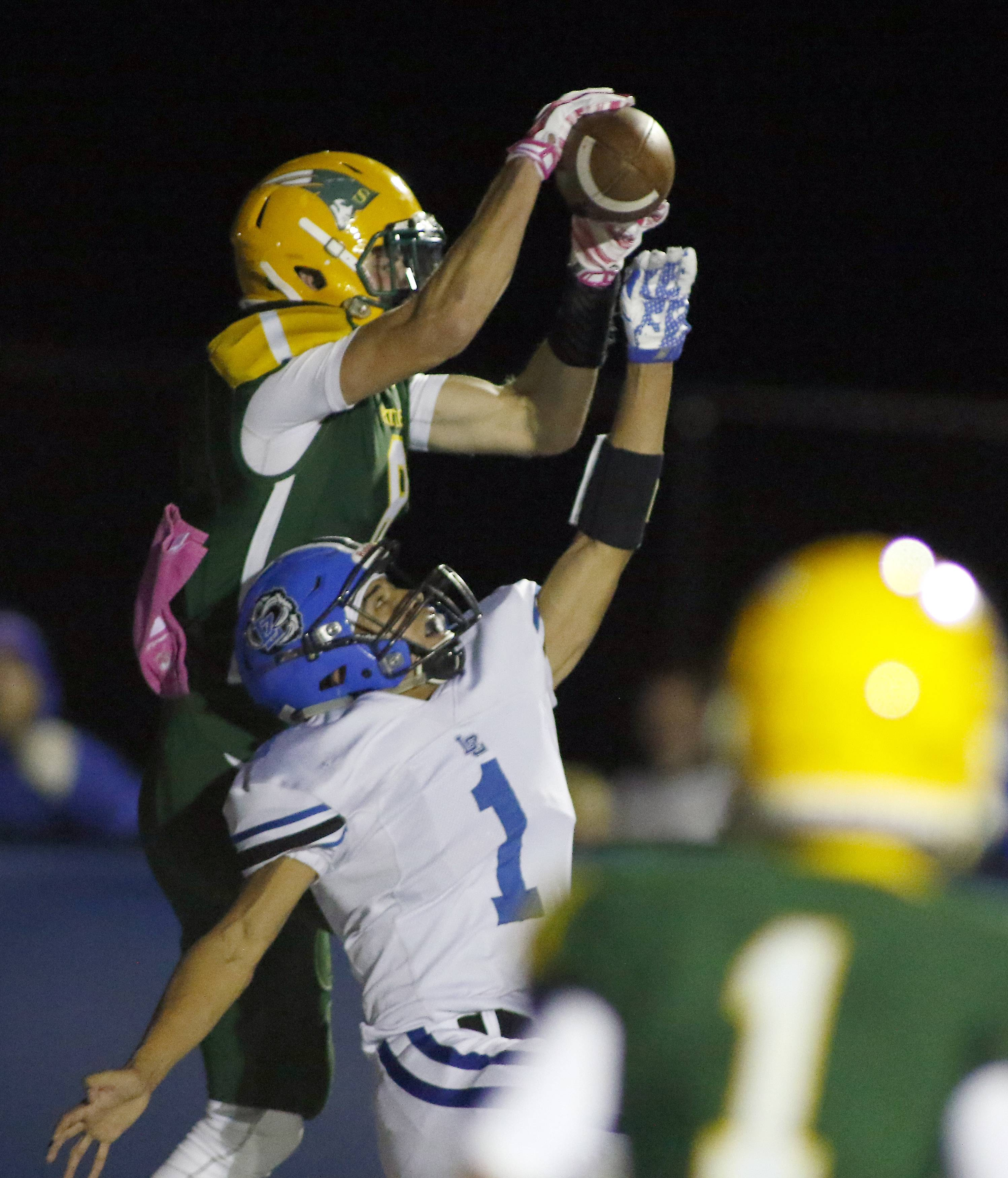 Stevenson's Michael Marchese reels in a touchdown pass with Lake Zurich's Derrick Juarez defending Friday at LZ.