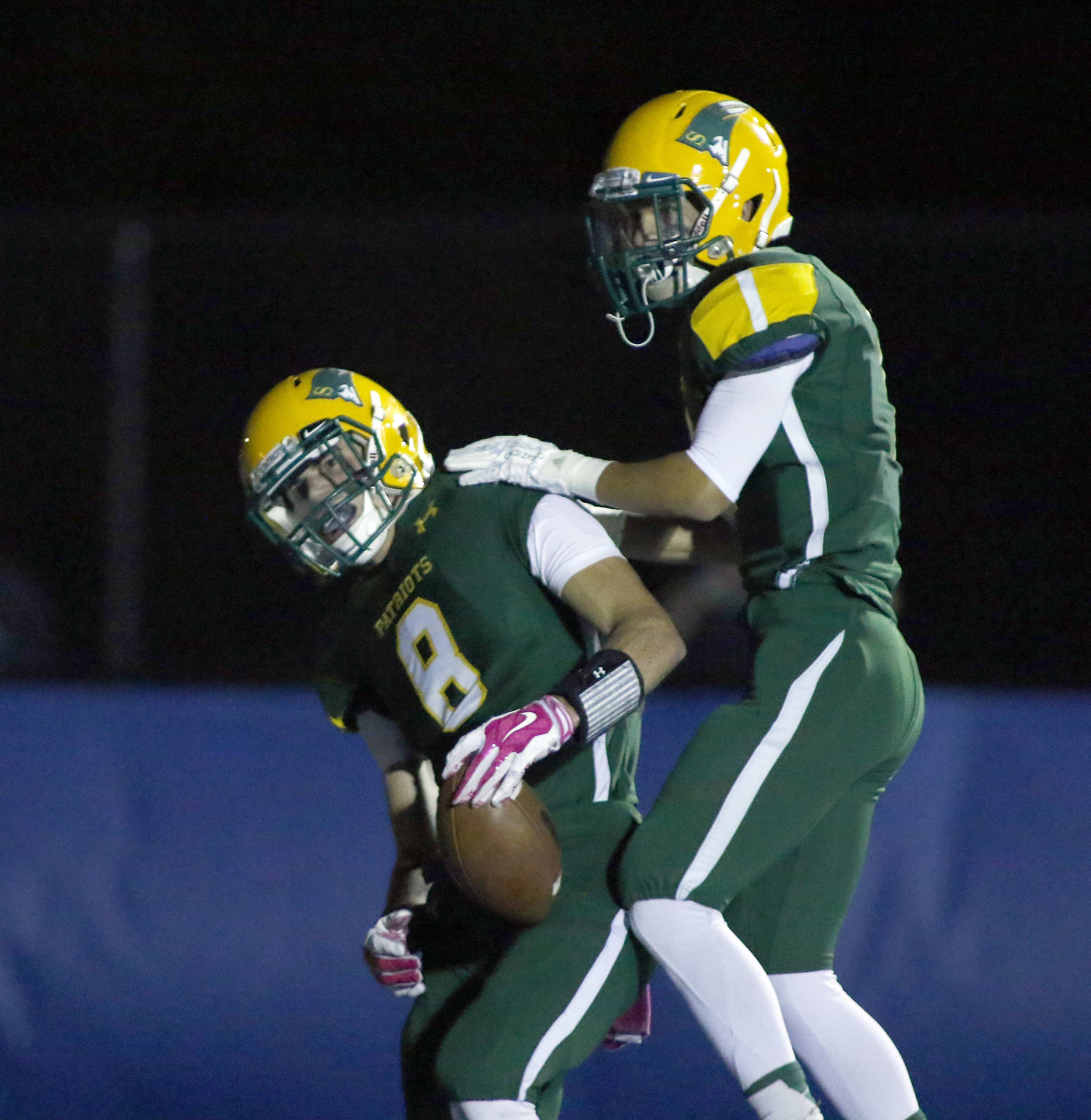 Stevenson's Michael Marchese ( 8) and Noah Lukz (1) celebrate after a Patriots touchdown Friday at Lake Zurich.