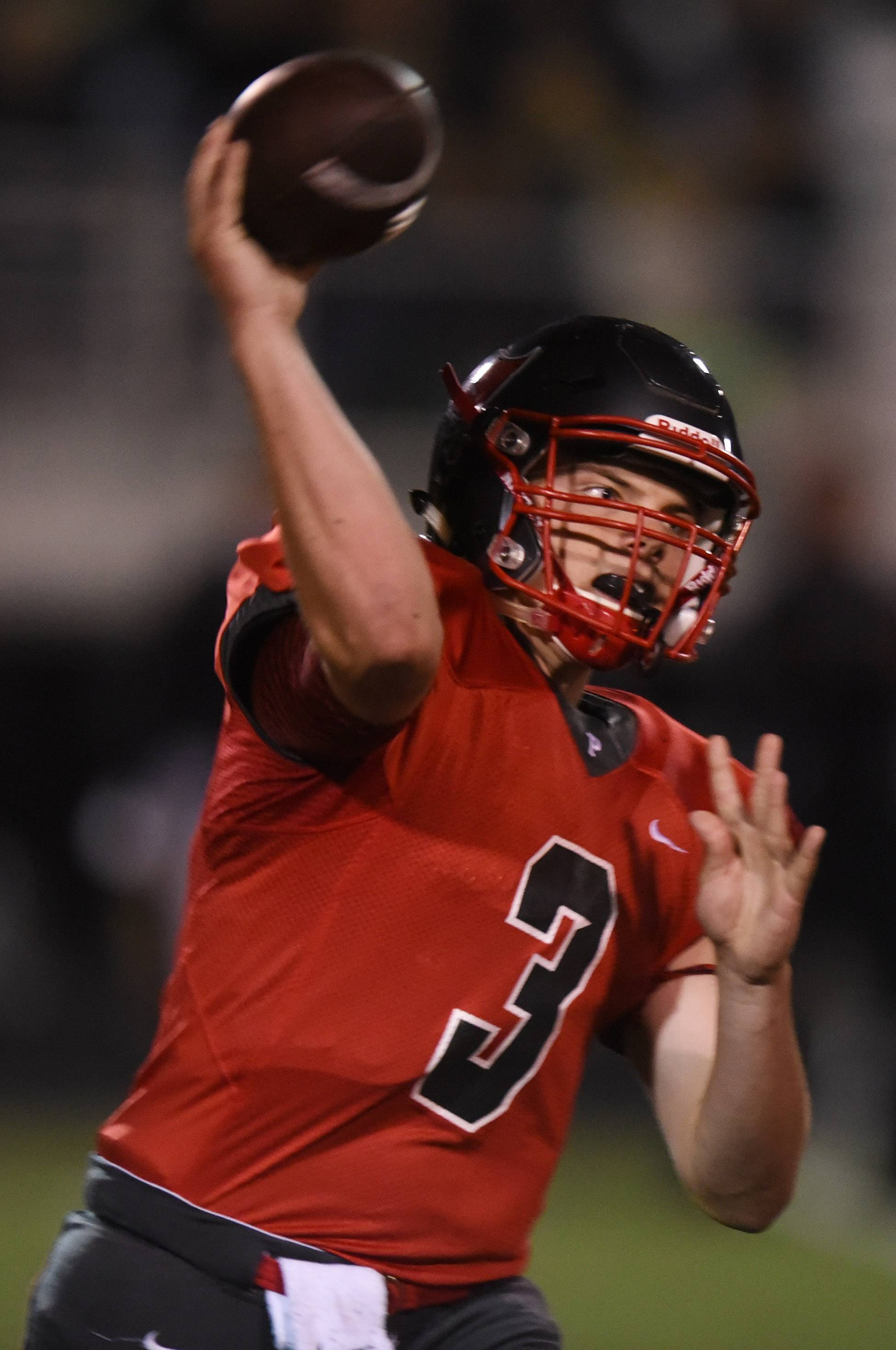 Palatine quarterback Zach Oles throws a pass during the Pirates' Week 6 victory against Fremd.