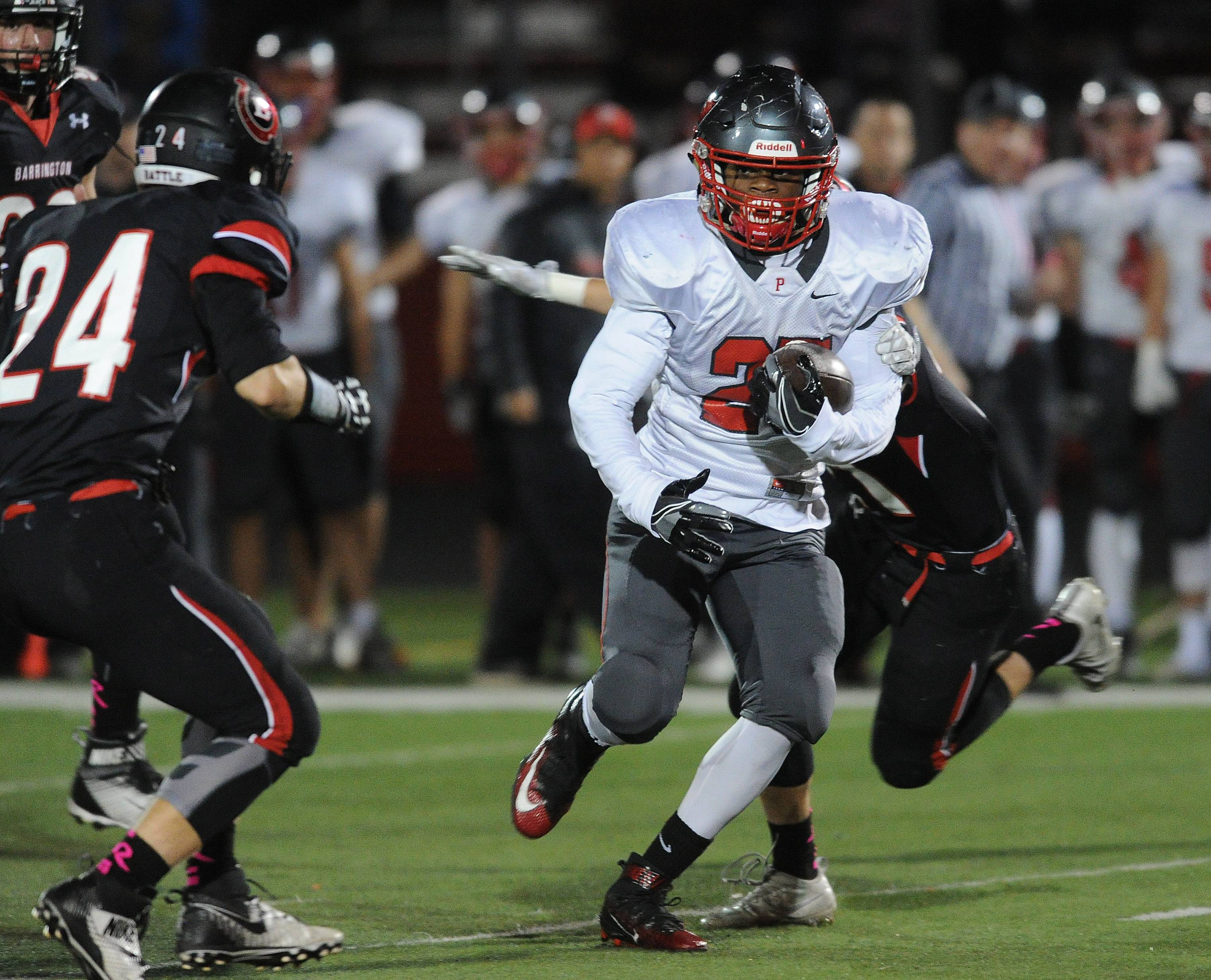Palatine's Joshua Turner breaks through Barrington's defense on Friday at Barrington Community Stadium.