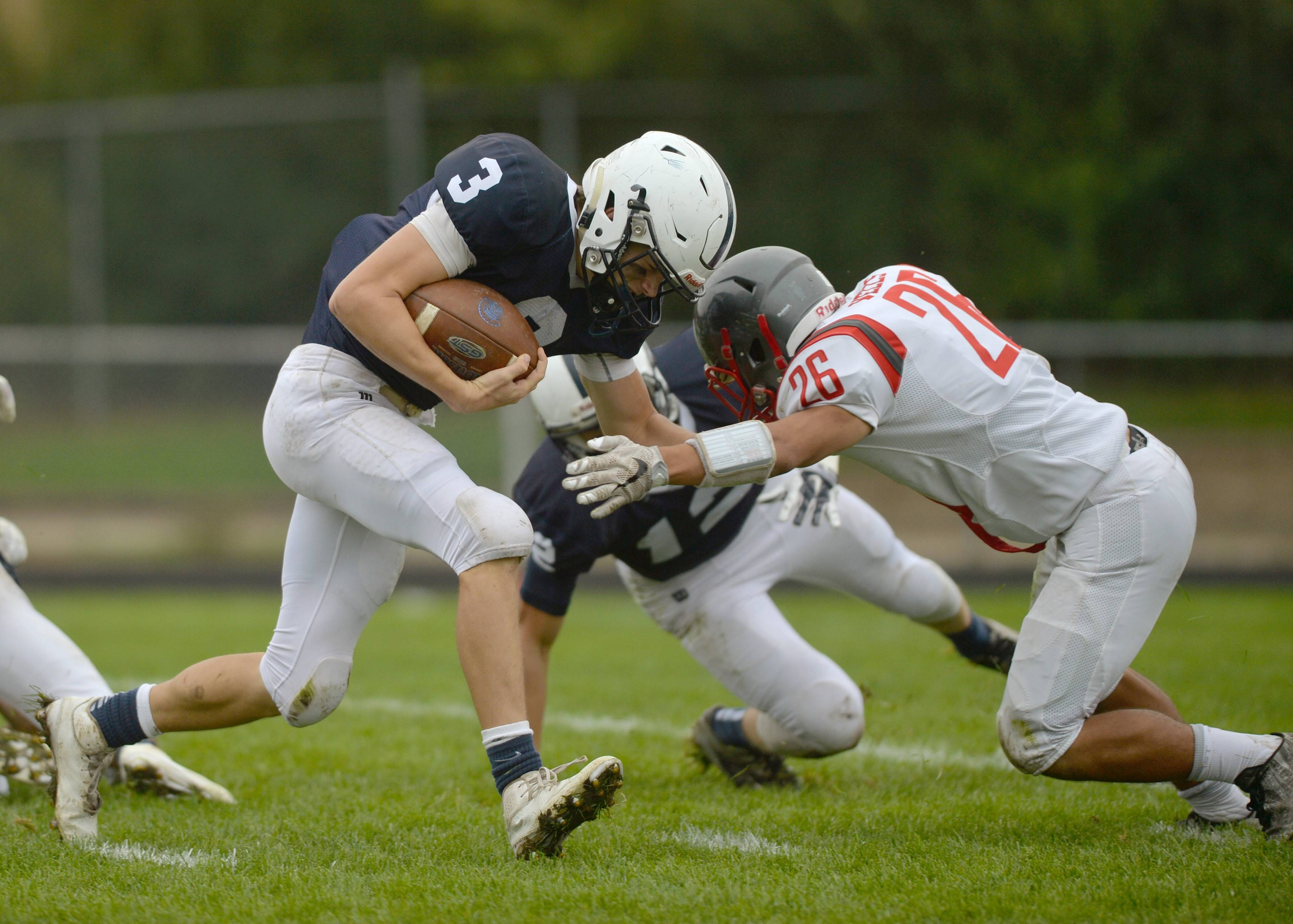 Cary-Grove quarterback Bobby Collins fights his way through South Elgin in the second quarter Saturday in Cary.