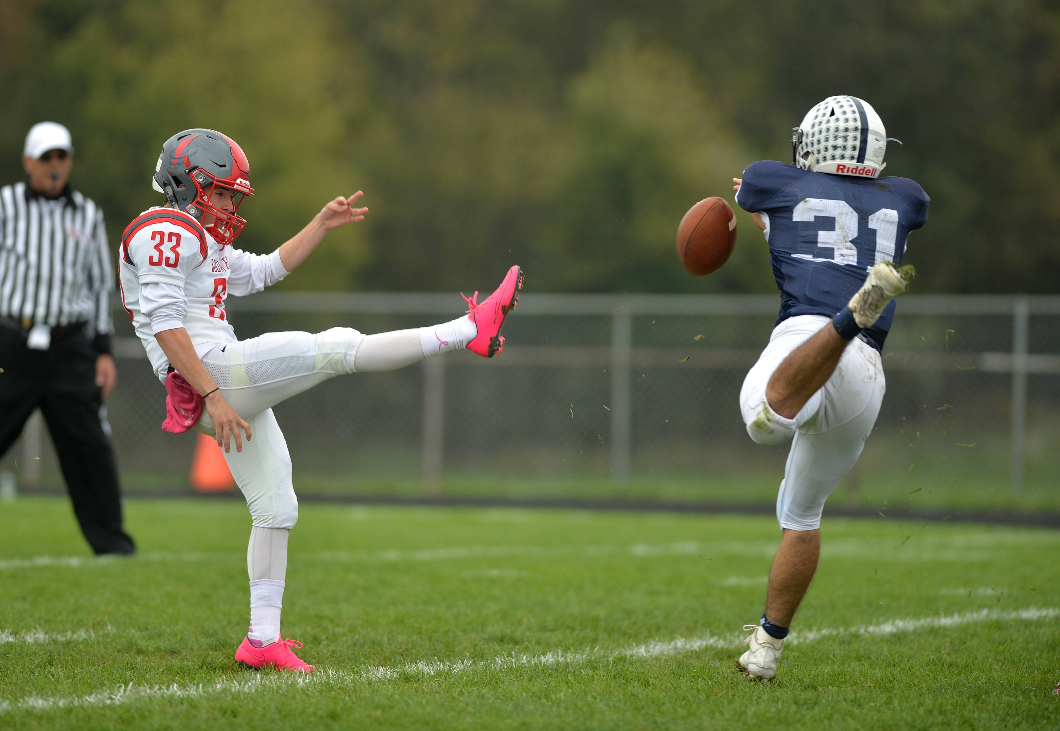 Cary-Grove defensive back Max Skol blocks a punt by South Elgin kicker Nicholas Farfan in the first quarter Saturday in Cary.