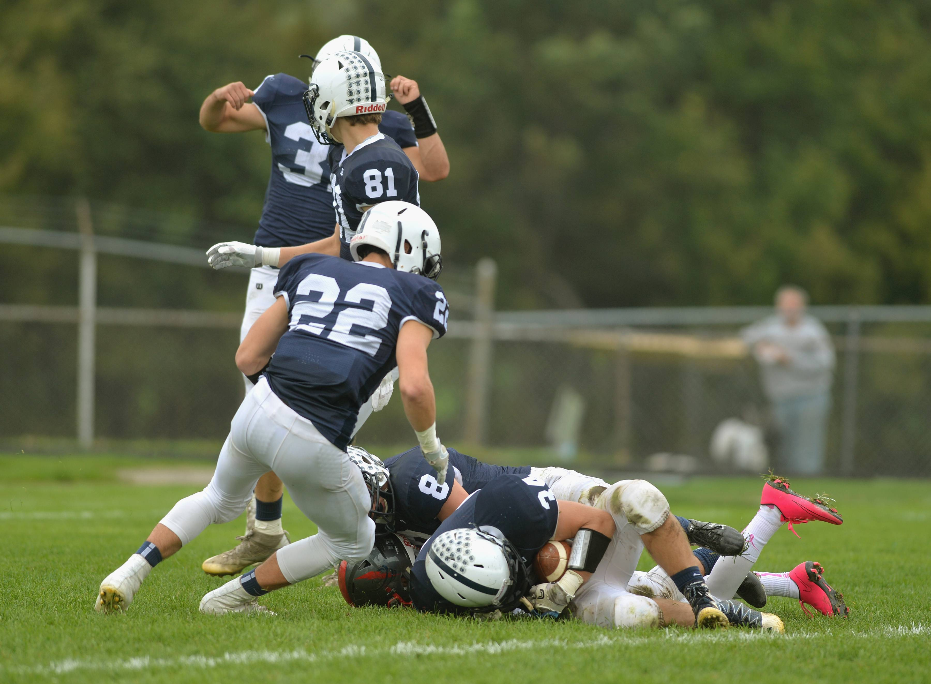Cary-Grove defensive back Kevin Pedersen recovers the ball in the end zone for a touchdown after a blocked punt in the first quarter Saturday in Cary.