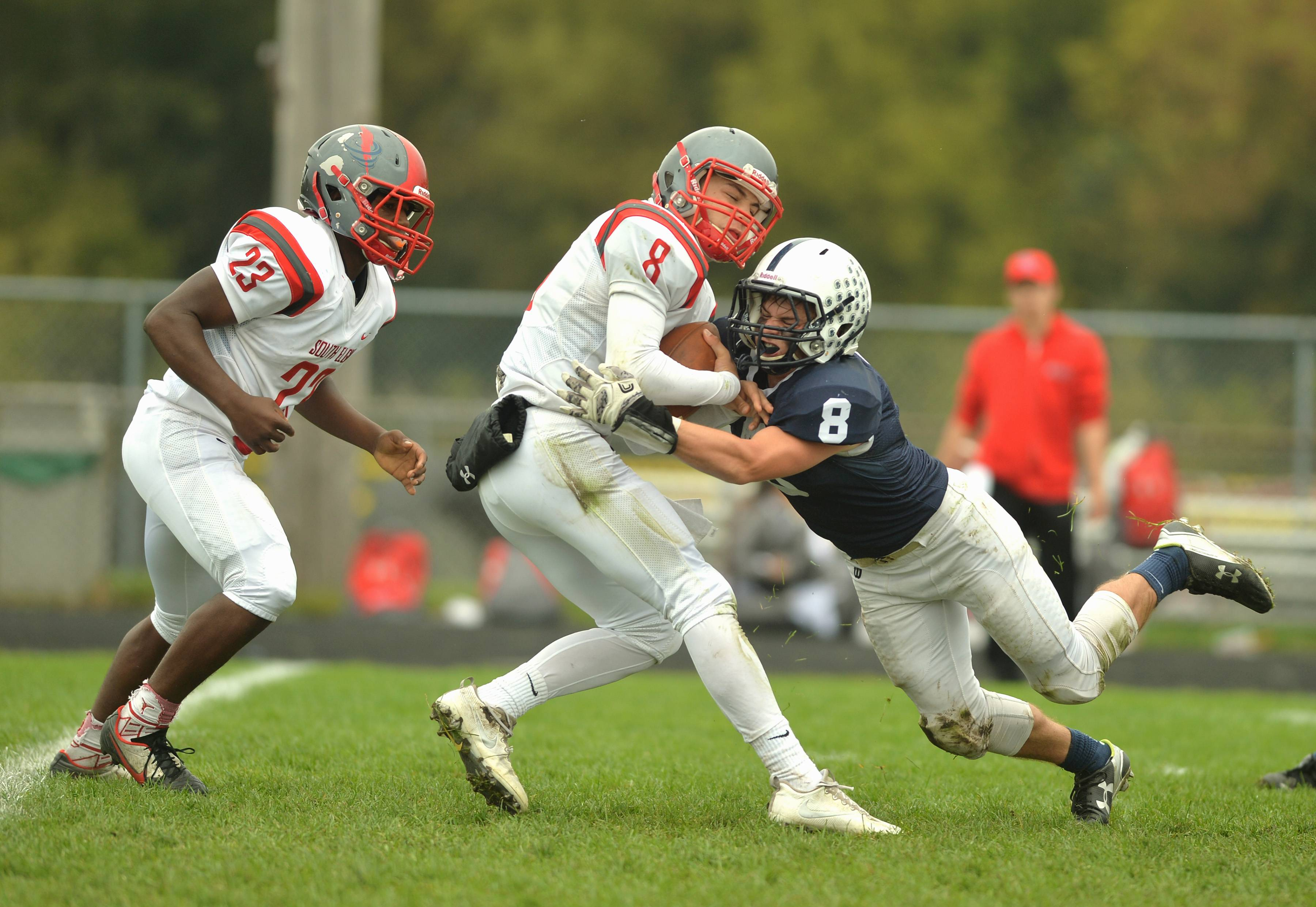 Cary-Grove defensive back Collin Walsh sacks South Elgin quarterback Nate Gomez in the first quarter Saturday in Cary. Gomez was knocked out of the game on the play.
