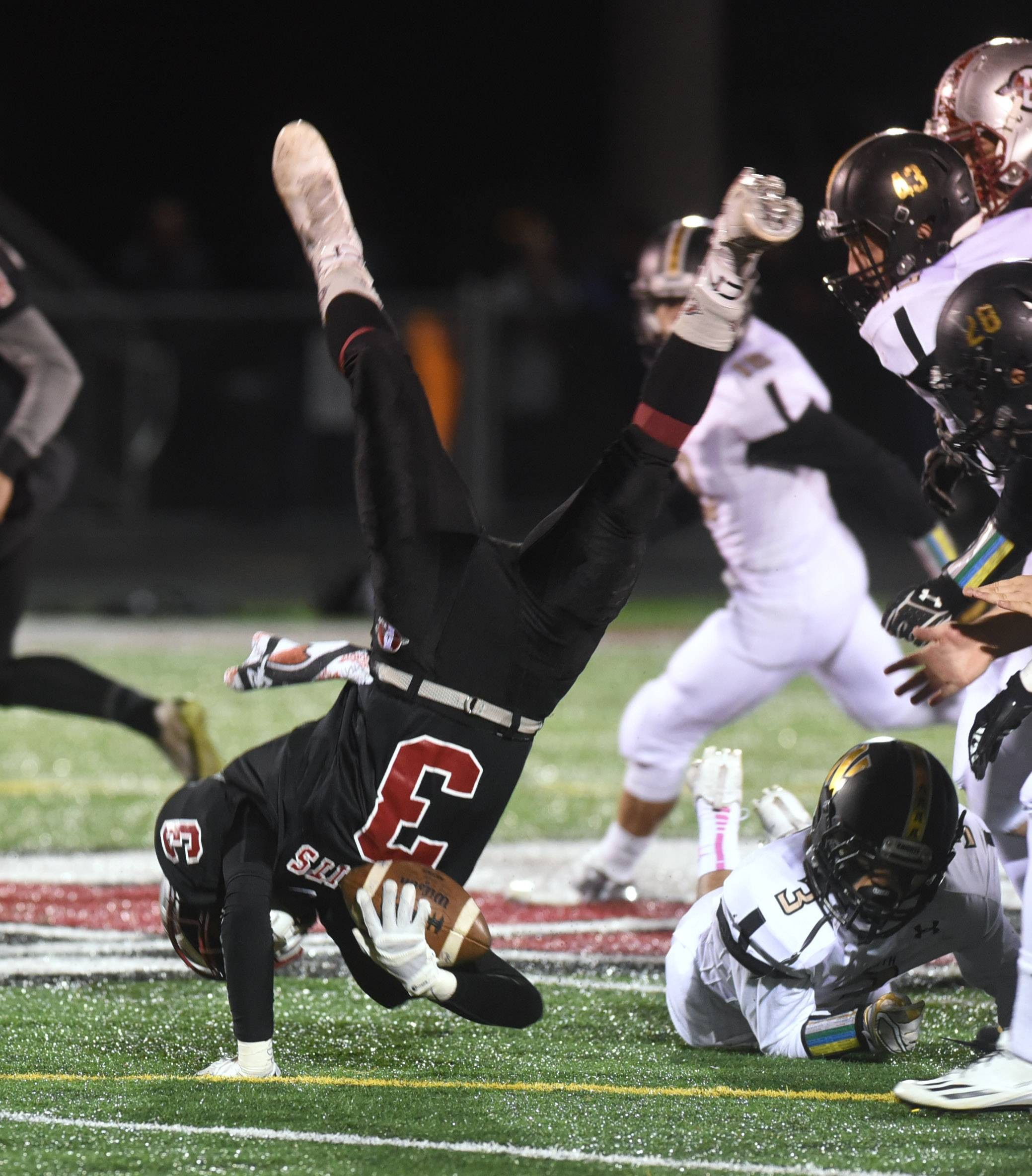 Antioch's Drew Porter (3) is upended by Grayslake North's Sam Nayyer (3) during the first half of Friday in Antioch. The Sequoits drew a No. 2 seed in Class 6A and will meet Wauconda, while No. 6 Grayslake North is matched up against Lakes in first-round playoff games.
