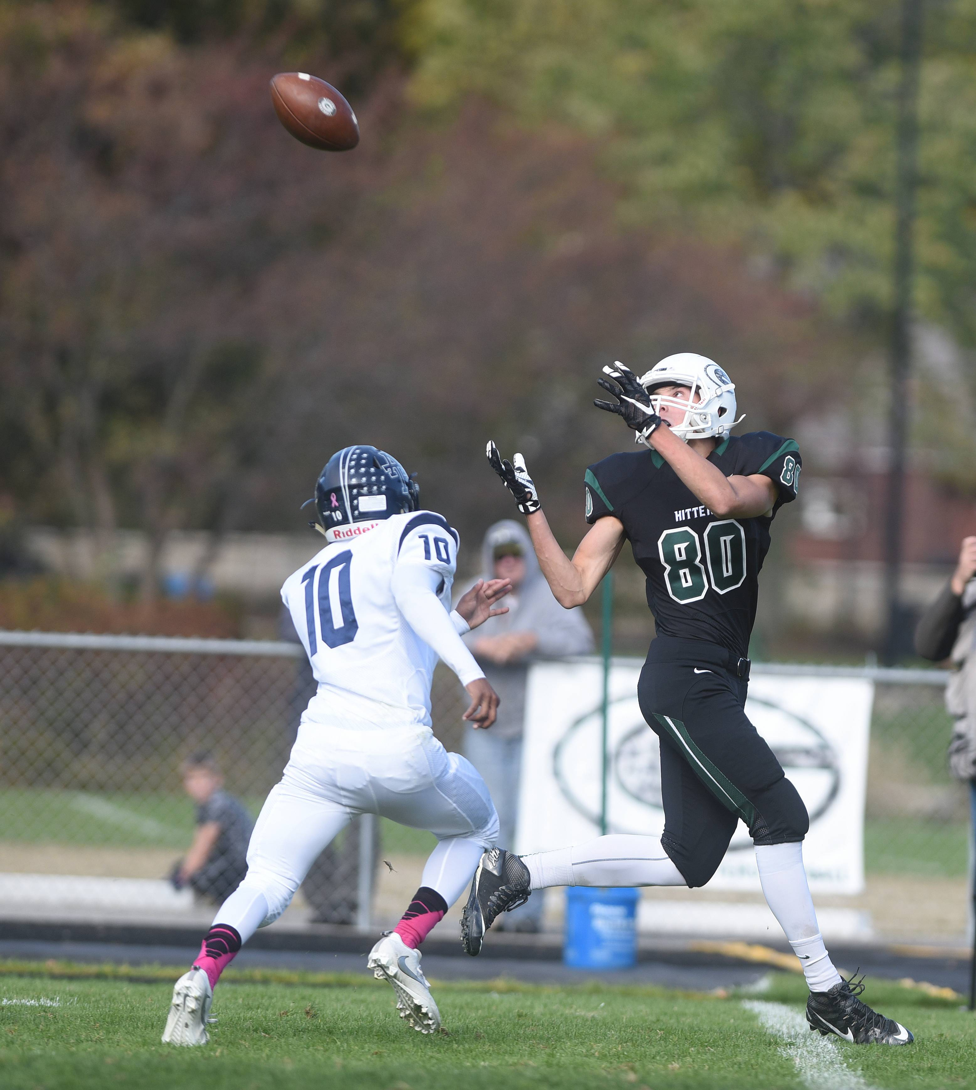Addison Trail's Christopher Purdy (10) and Glenbard West's Alec Pierce (80) chase a pass during the Addison Trail at Glenbard West football game Saturday.
