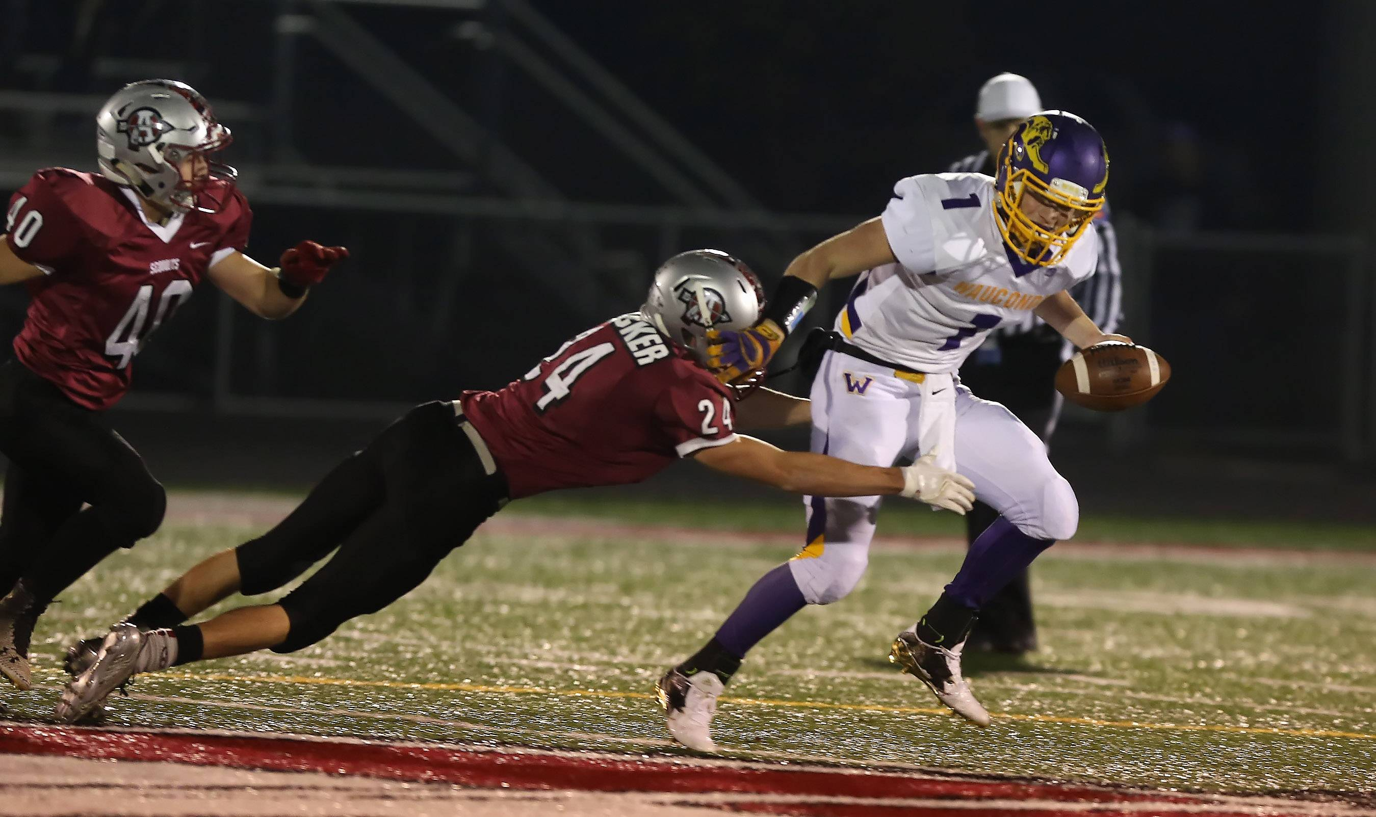 Antioch defender Bill Becker sacks Wauconda quarterback Antonio Acosta in the first half at Antioch on Friday.