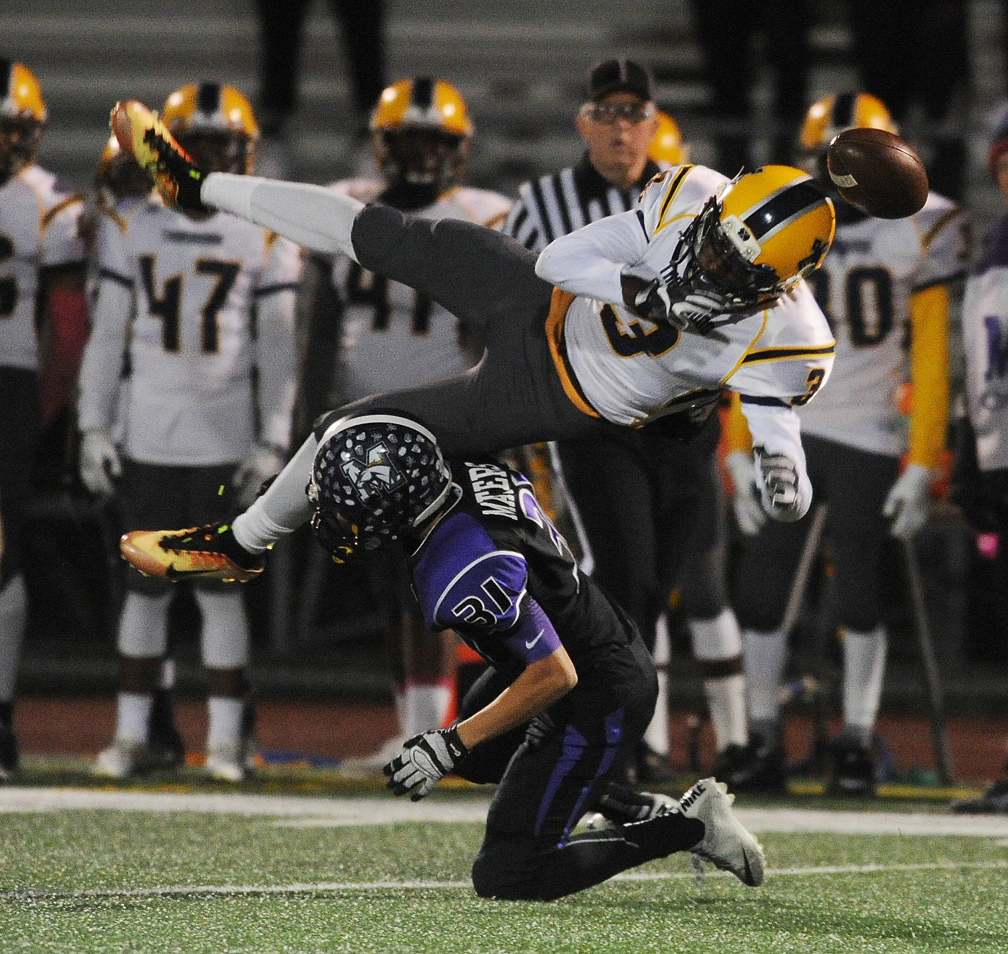 Rolling Meadows' Justin Masters sends Thornwood's DeMaris Williams flying on this incomplete pass play in the first half Friday at Meadows.