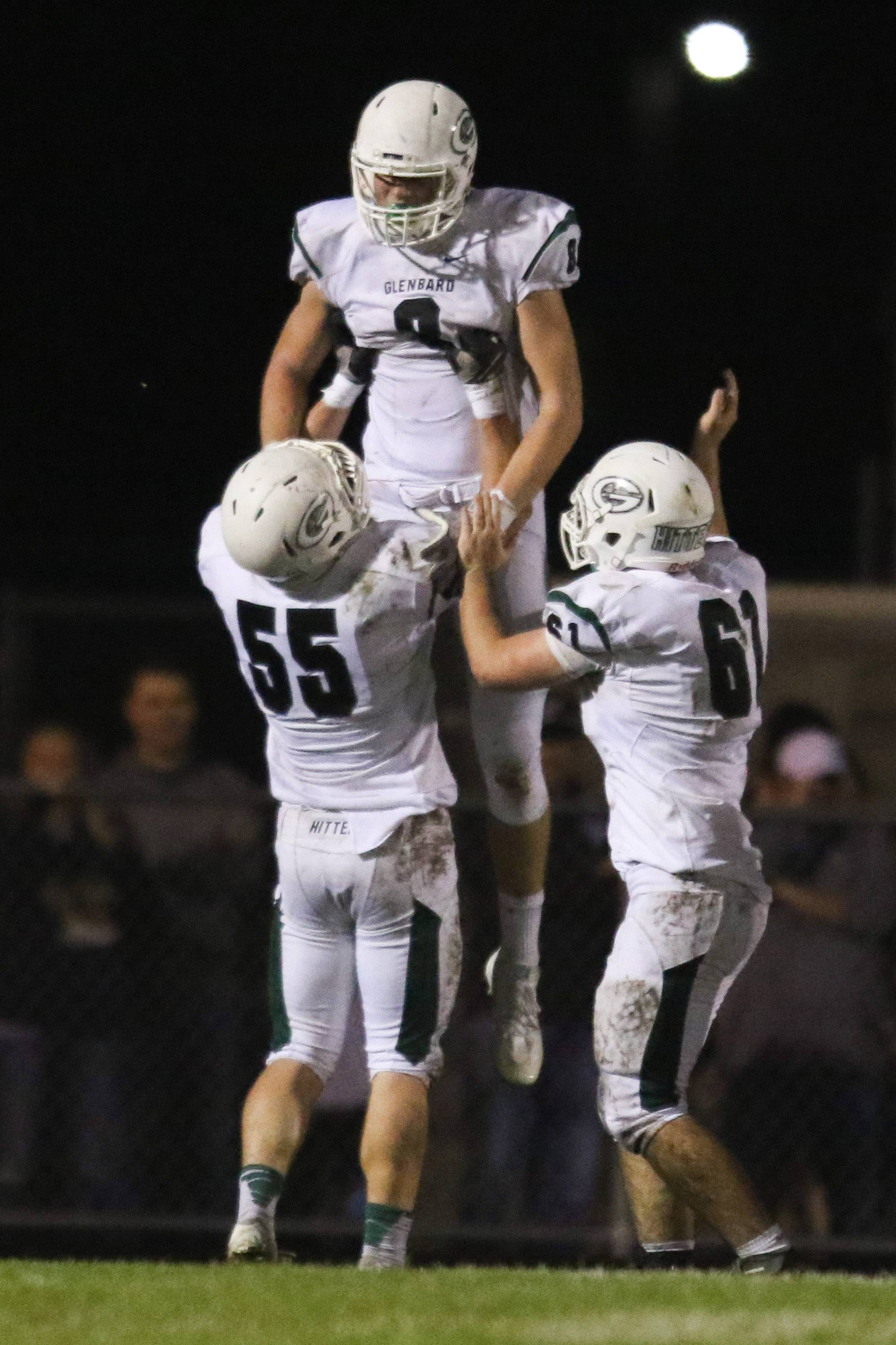 Glenbard West tight end Alex Pihlstrom (8) is lifted in the air by offensive lineman Will Farley (55) after scoring a touchdown against Neuqua Valley at Neuqua Valley High School in Naperville, IL on Saturday, October 29, 2016