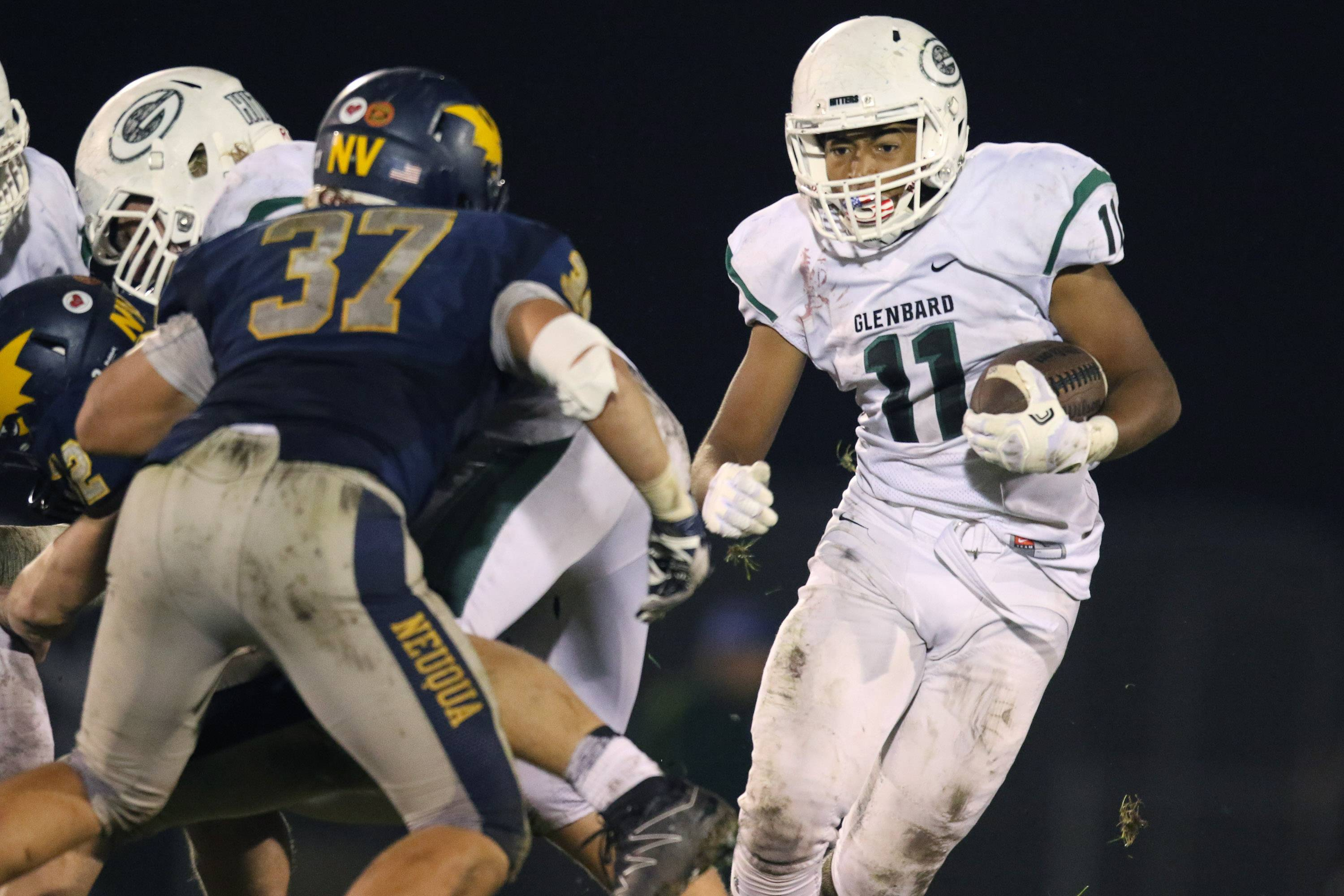 Glenbard West running back Dre Thomas (11) carries the ball against Neuqua Valley at Neuqua Valley High School in Naperville, IL on Saturday, October 29, 2016
