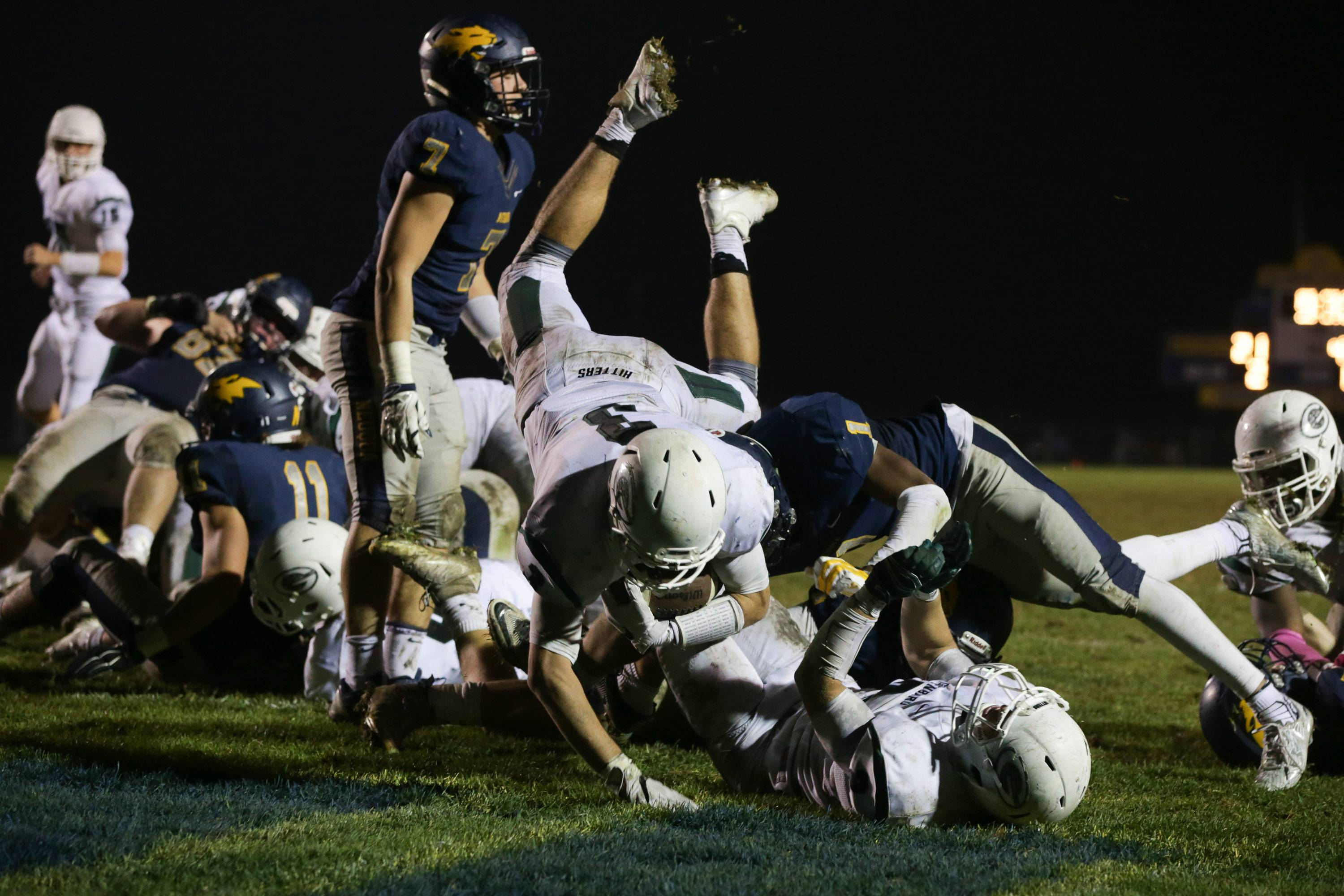 Glenbard West running back Jackson Goleash (3) dives in to the end zone for a touchdown against Neuqua Valley at Neuqua Valley High School in Naperville, IL on Saturday, October 29, 2016