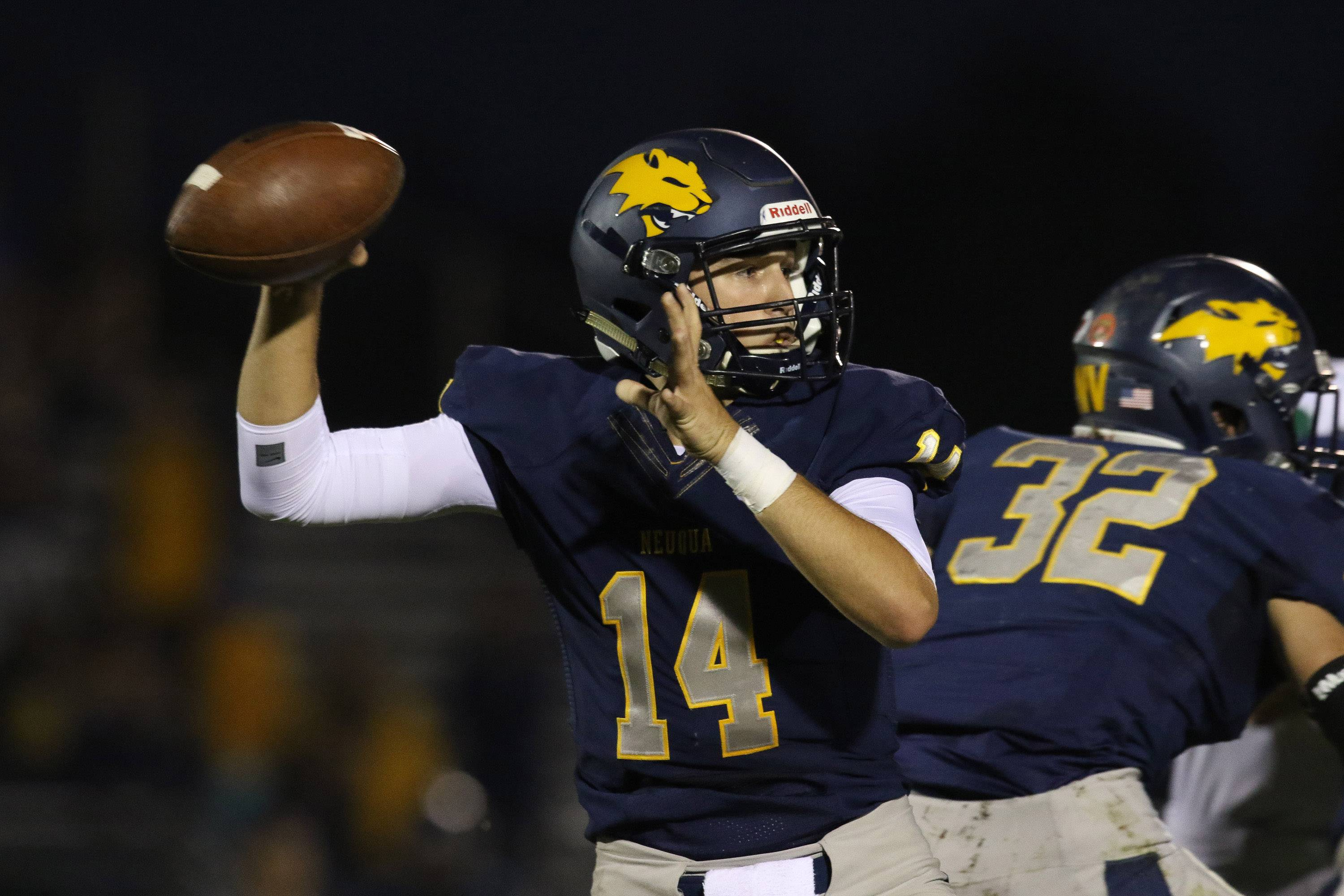 Neuqua Valley quarterback Jake Eskoff (14) drops back to pass against Glenbard West at Neuqua Valley High School in Naperville, IL on Saturday, October 29, 2016