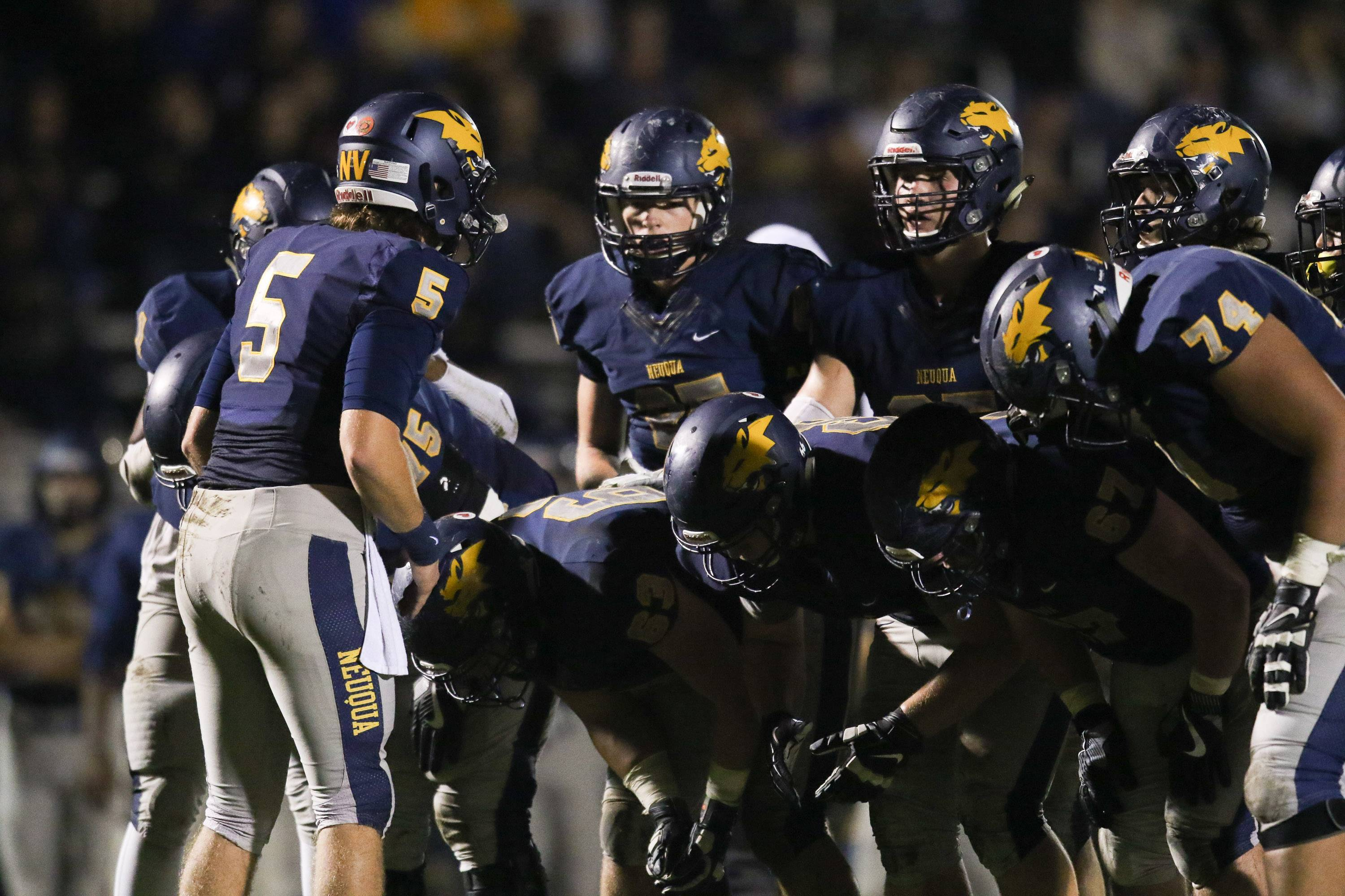 Neuqua Valley quarterback Jack Bastable (5) talks to his team during a huddle against Glenbard West at Neuqua Valley High School in Naperville, IL on Saturday, October 29, 2016