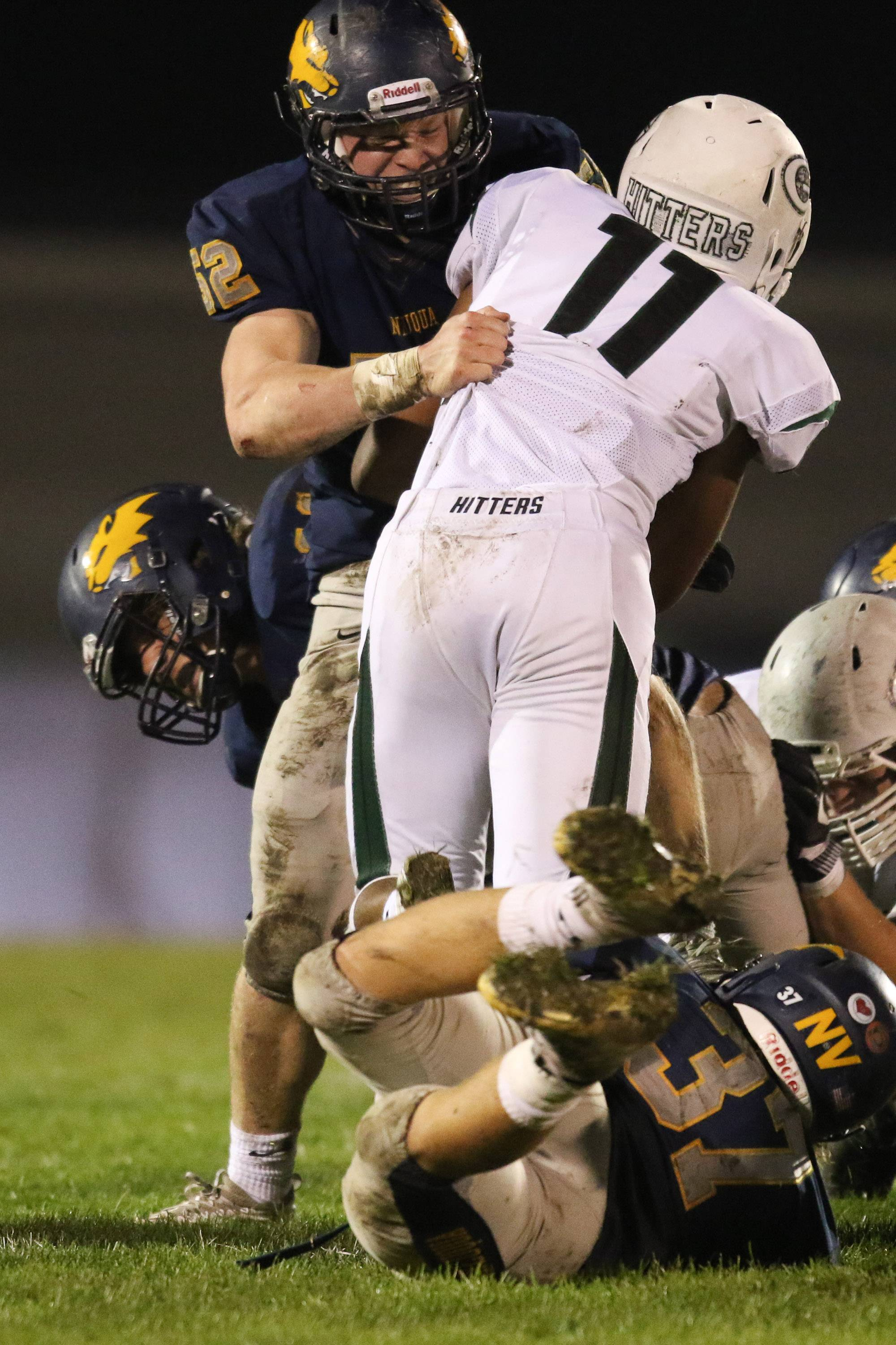Neuqua Valley nose guard Jackson Keating (52) hits Glenbard West running back Dre Thomas (11) for a loss at Neuqua Valley High School in Naperville, IL on Saturday, October 29, 2016