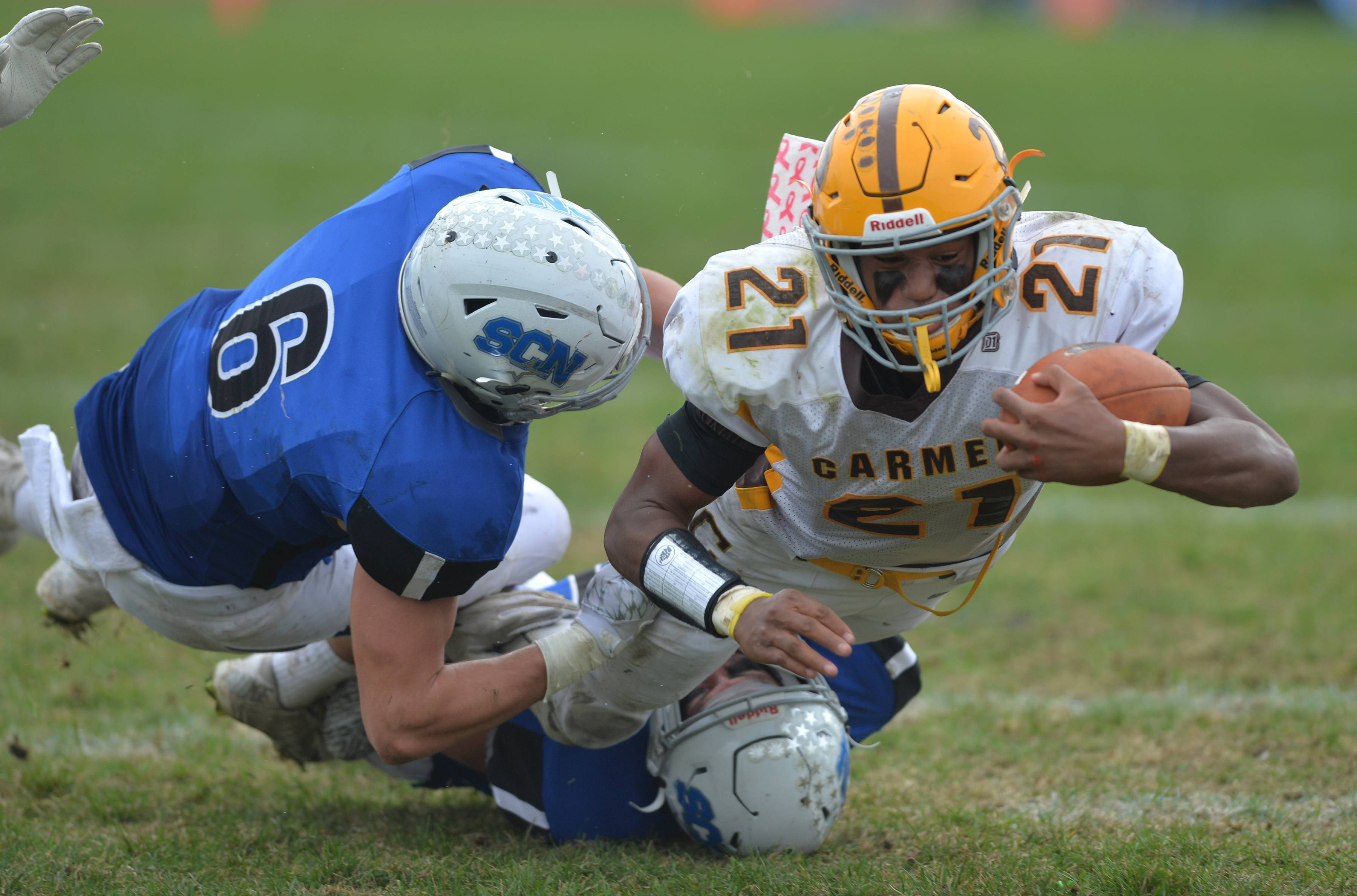 Carmel back Zaire Barnes lunges forward for extra yardagein the third quarter of their IHSA Class 7A playoff age Saturday in St. Charles. The North Stars advanced with a 31-24 double overtime win.