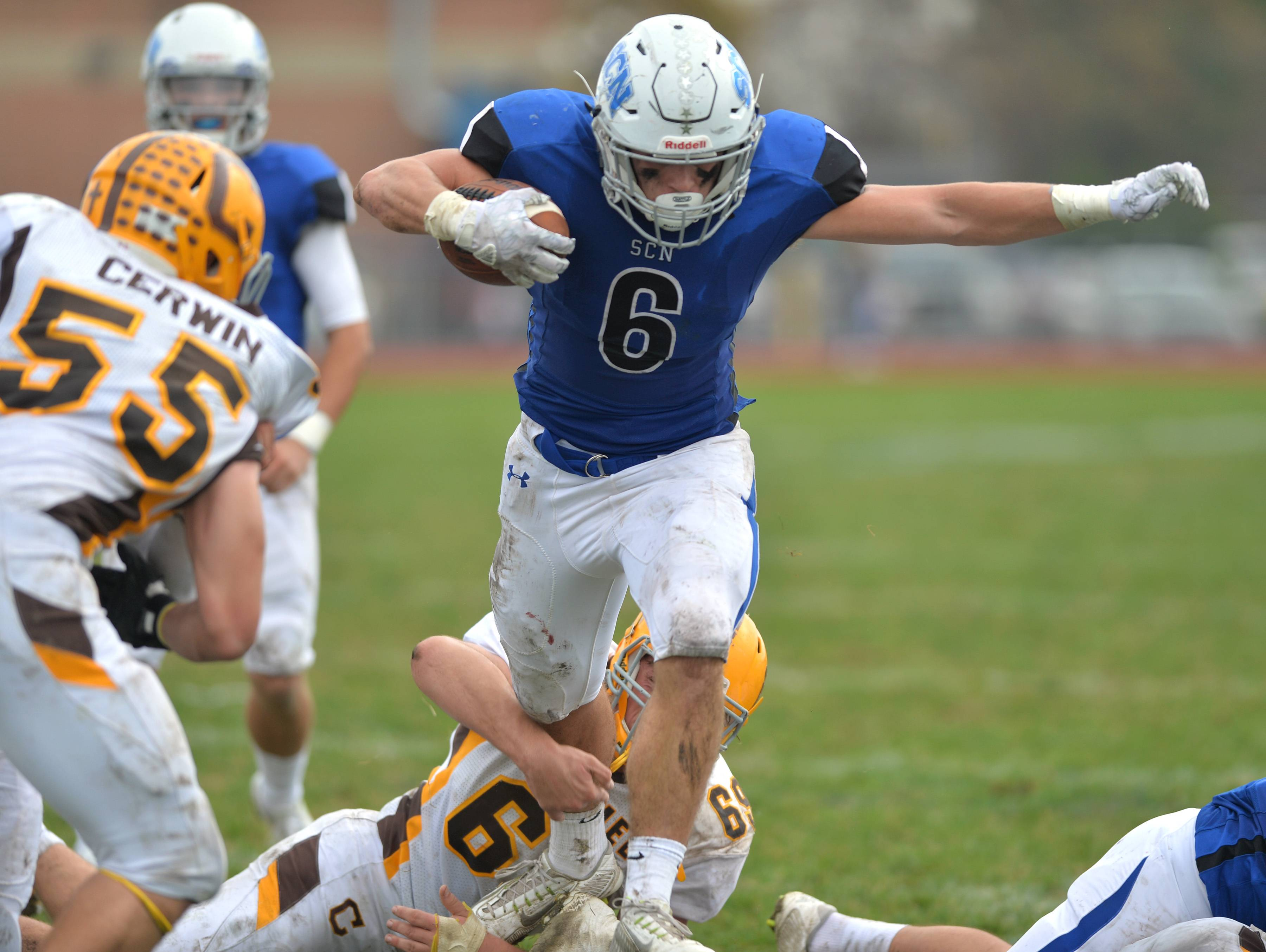 St. Charles North's Tyler Nubin carries for a touchdown against Carmel in an IHSA Class 7A playoff game Saturday in St. Charles.