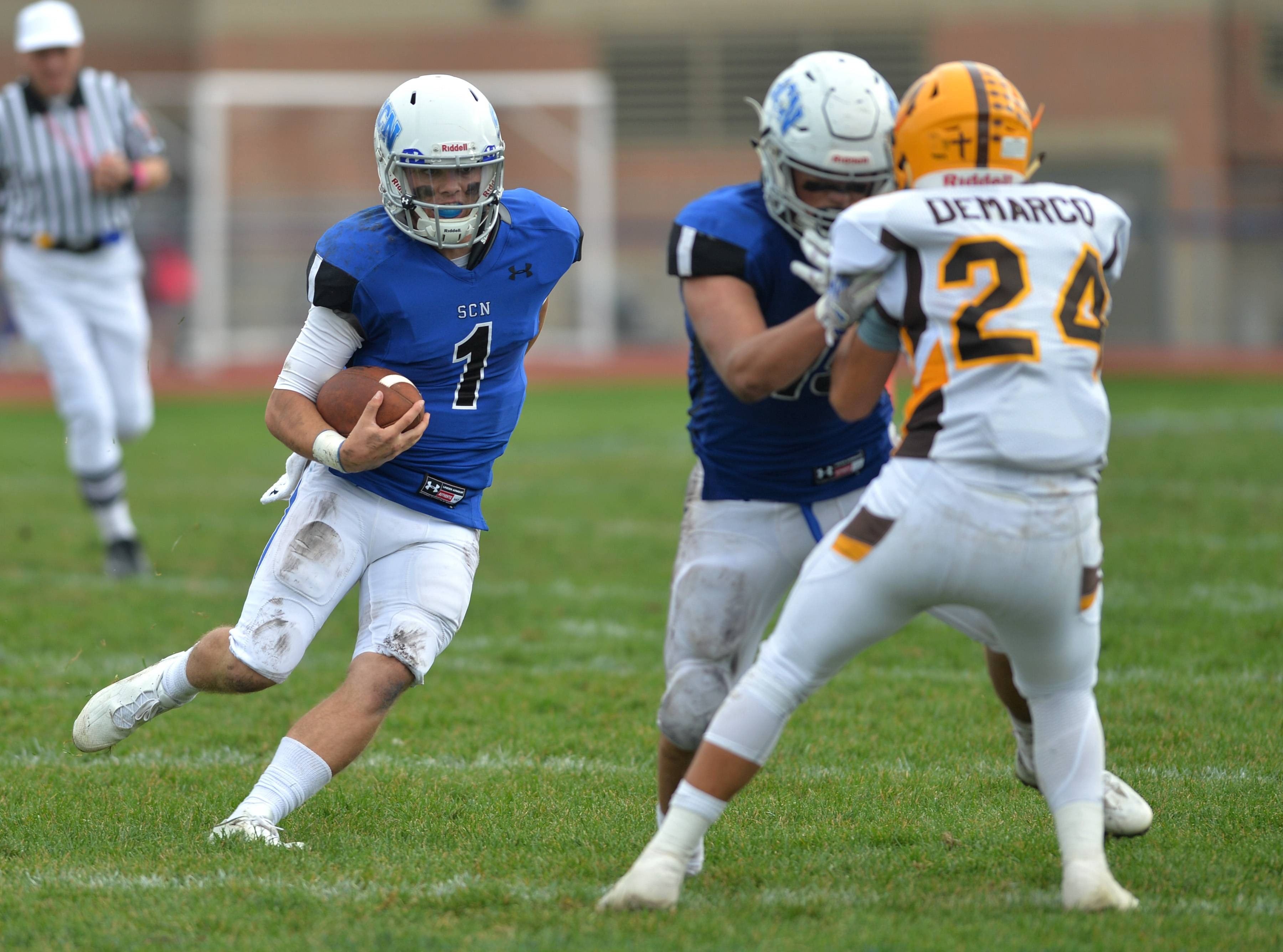 St. Charles North quarterback Zach Mettetal runs on a keeper in the fourth quarter of the North Stars' IHSA Class 7A playoff with Carmel Saturday in St. Charles. The North Stars advanced with a 31-24 double overtime win.